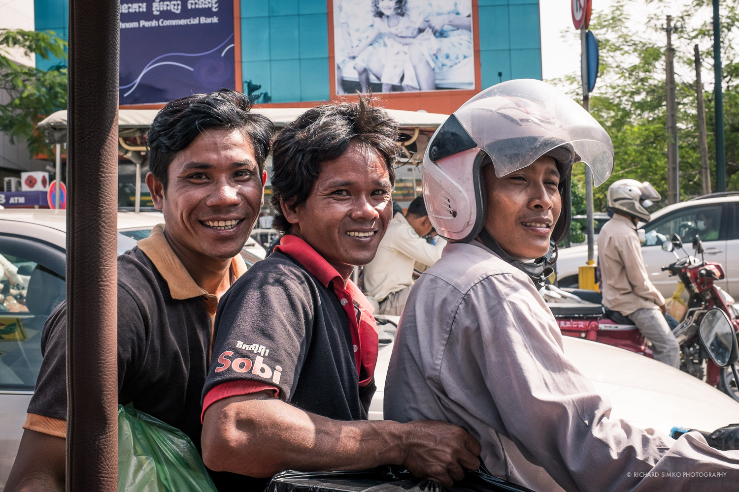 Tuk yuk stopped at red lights on the way to airport. A motorbike with this happy trio stopped next to us.  Always have your camera ready.