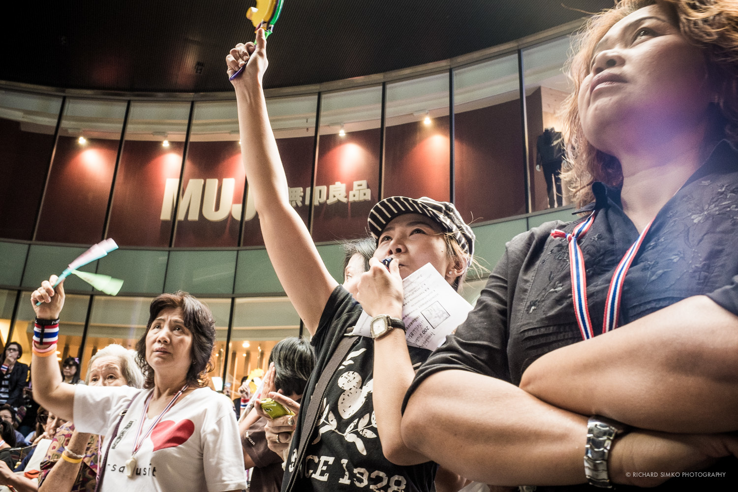Protesters cheering at Bangkok's Silom district protest.