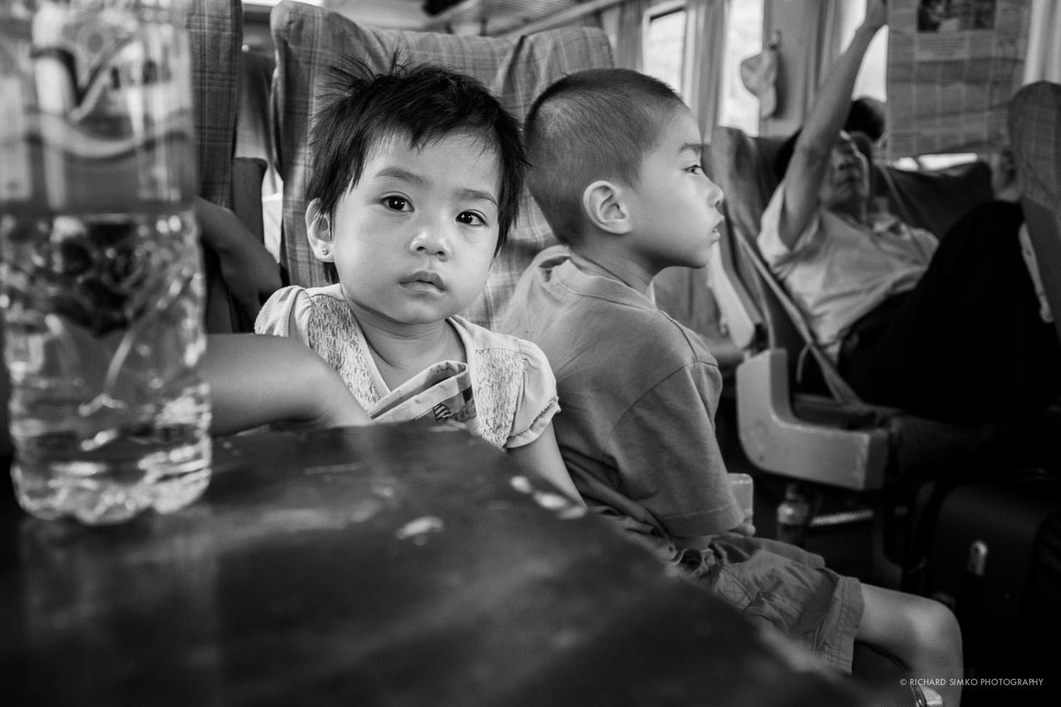 I travelled from Da Nang to Hue by train sitting with lovely family with two young kids. During 2 hours I spend photographing them they never noticed I am taking photographs. (Thank you Fuji X100s for non existent shutter noise). I loved the eyes of this little girl. Shooting from the hip or little folding table that are on trains I was lucky enough to catch her dreamy look.