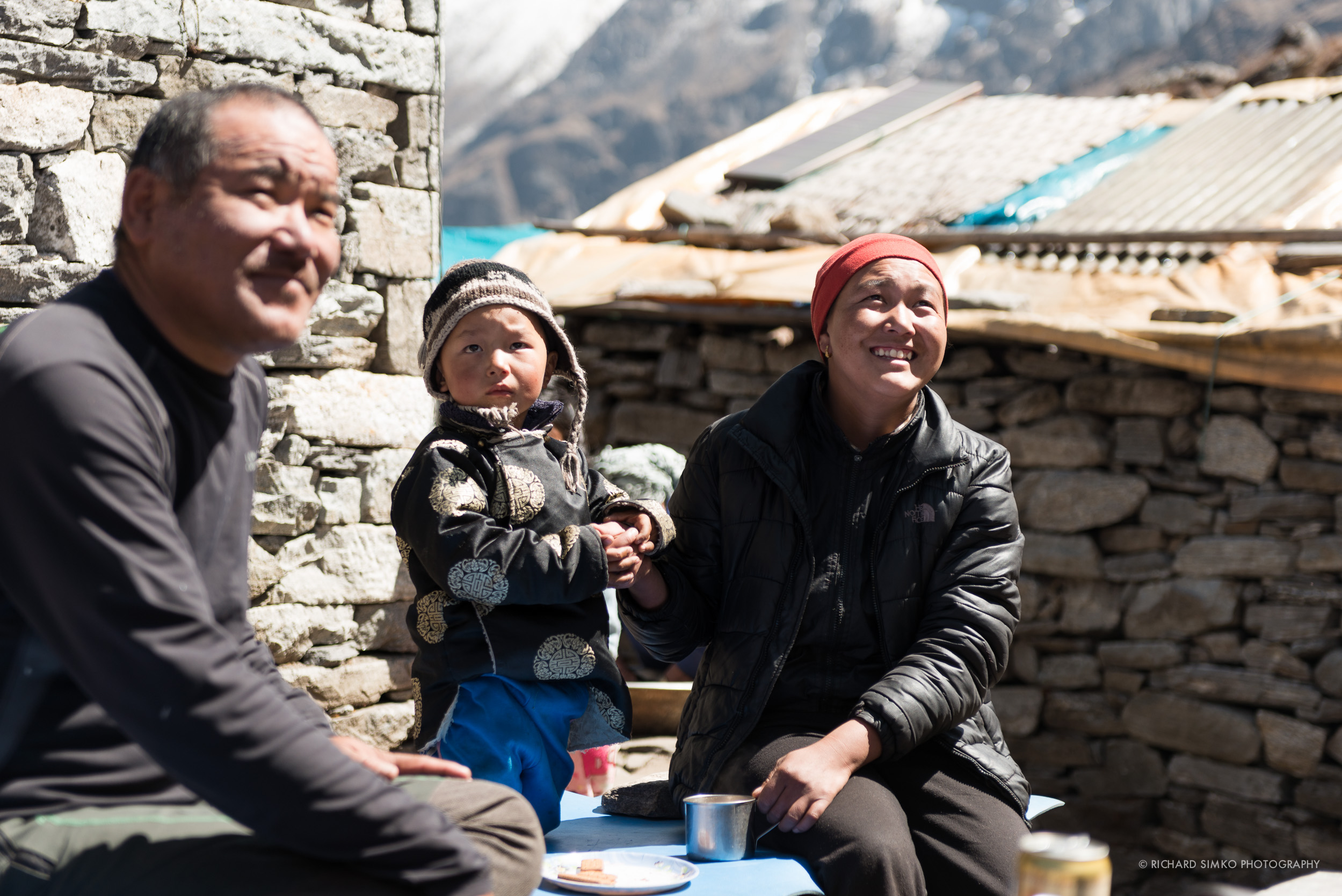 Moment for rest. Little Passang Sherpa and his mother are observing people descending from Zatrwa Pass.