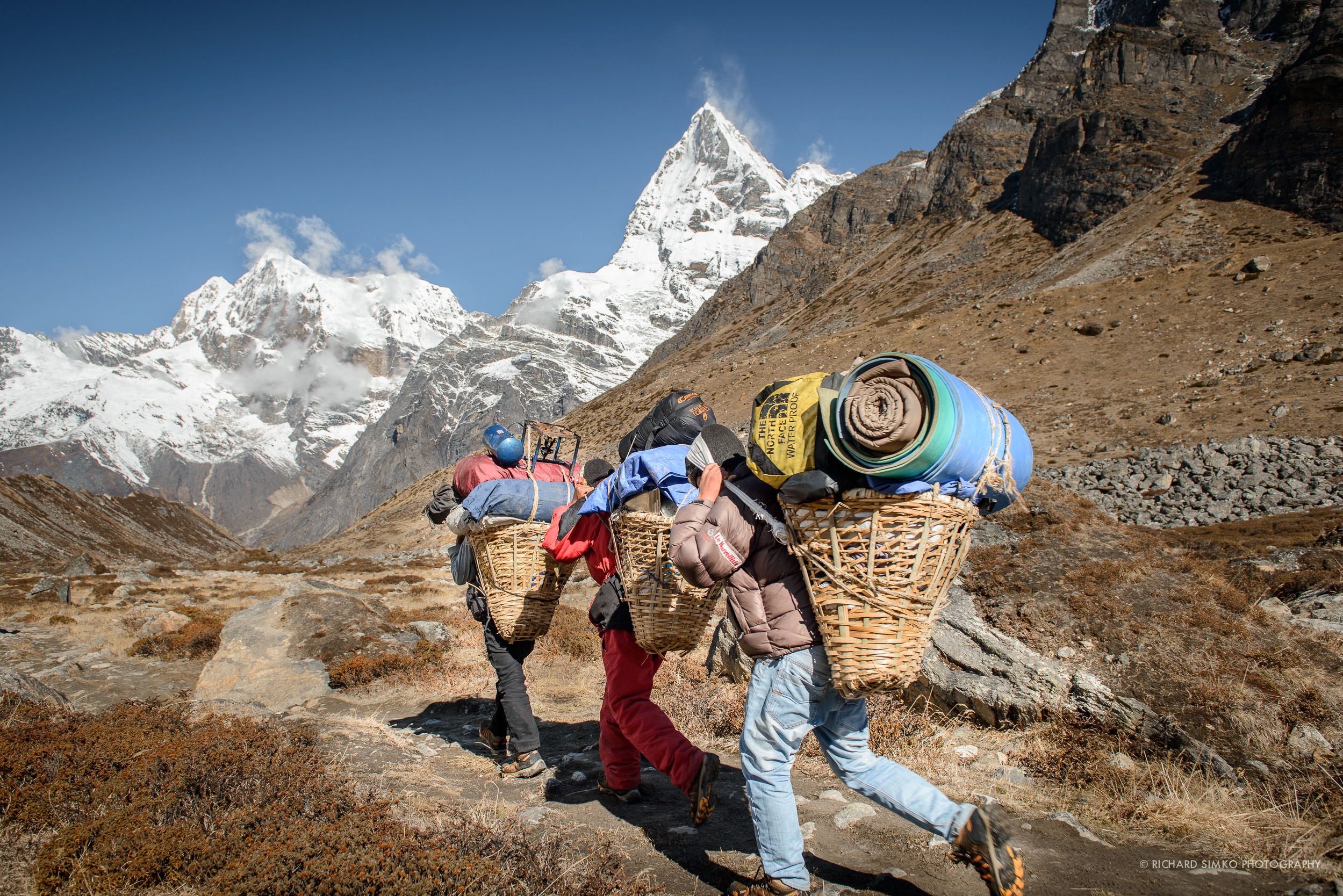 Sherpa porter trio on the way from Khare to Thangnak