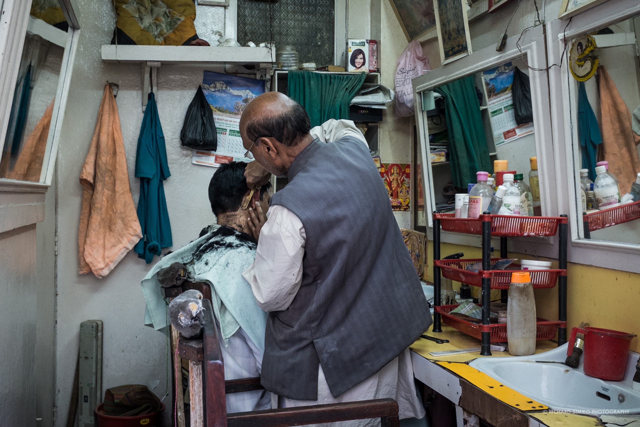 """Barber shop in Thamel or """"Quick Cuts"""" in Nepali style."""