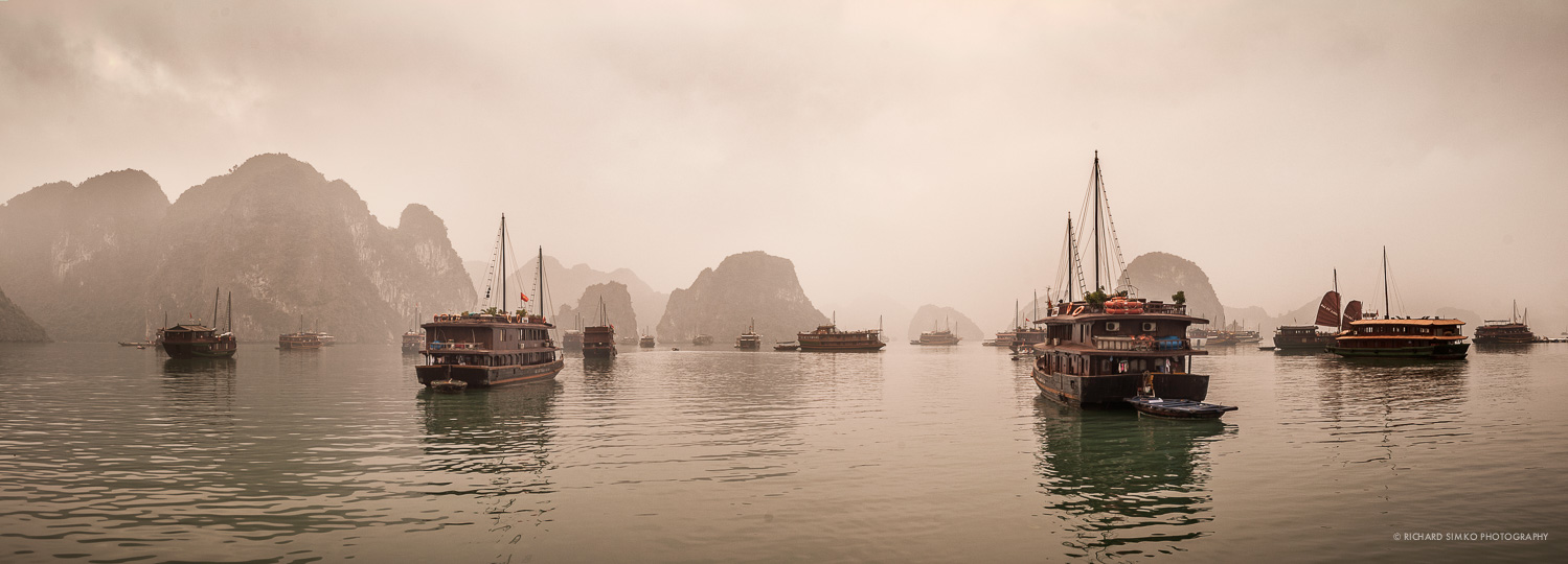 Halong Bay panorama is a good example of an image where even tripod with nodal head would be useless. It was shot from a boat. The two closest junk boats are the main subjects and I made sure that there is an image in the sequence that contains the whole boat.