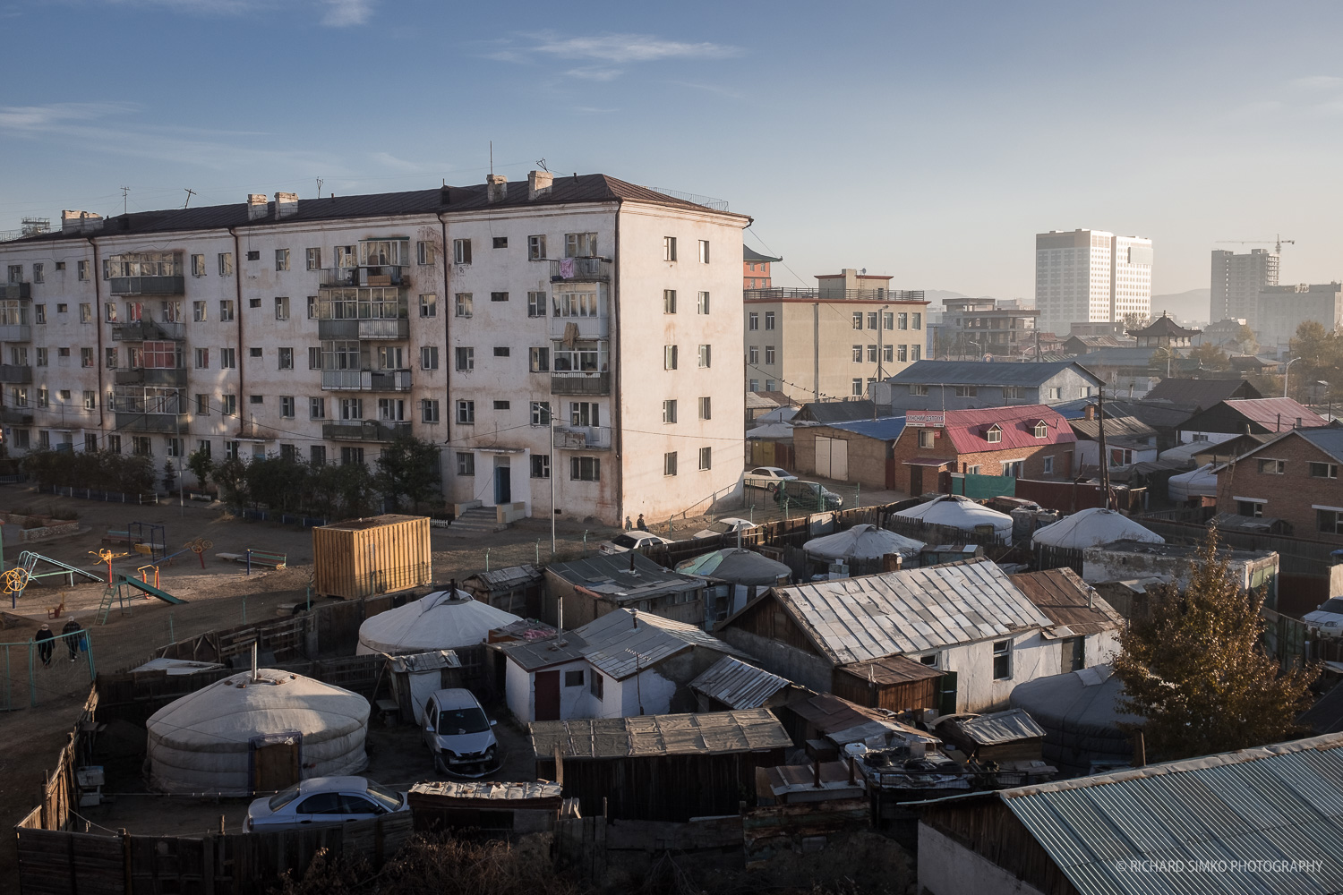 This is Ulaanbaatar how I expected to see it. Block of residential buildings built in conservative Russian style with space in between filled up with gers.