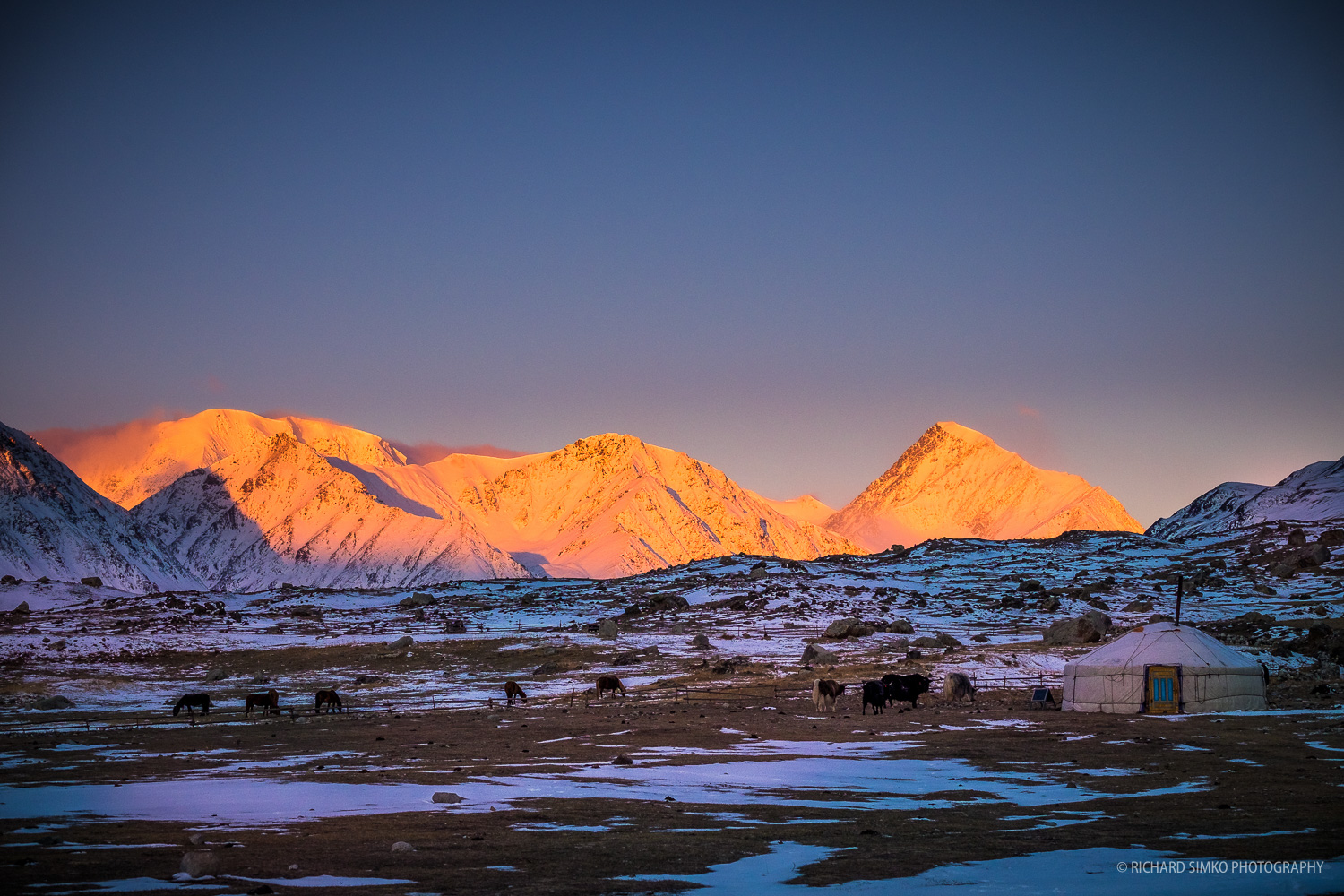 Sunrise at Altai mountains. Chitin peak is the spiky one on the right.