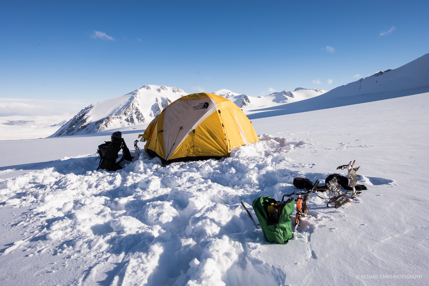 Advanced base camp sitting in upper section of Potanin Glacier.