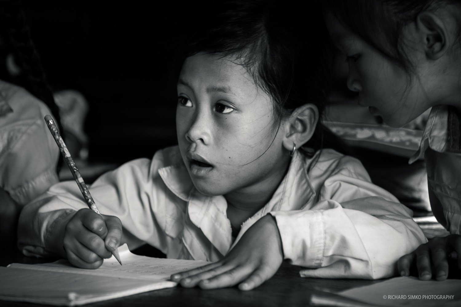 Student doing her task. Orphanage in Tonle Sap floating village.  Fujifilm X-T1, Fujinon 50-140mm   2.8