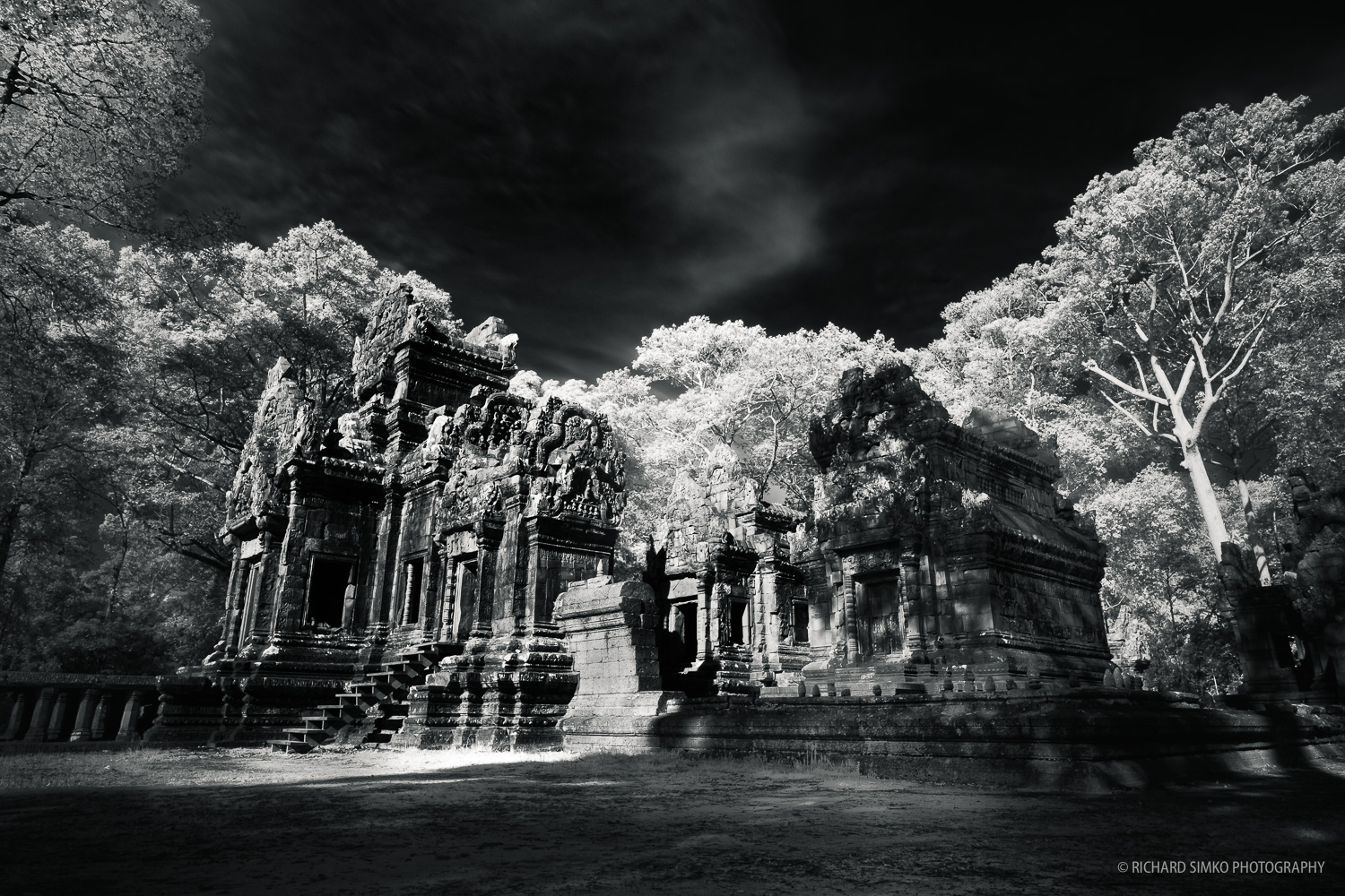 Cambodia is a hot and sunny country. Window of opportunity for photography during sunrise and sunset is very short. Most of the day the light is just too harsh for a nicely balanced photograph. However, that is the best condition to shoot infrared images. I was inspired by work of  John McDermott and his infrared photographs of Angkor temples. I gave it a go and I really like the result. Angkor temples look great in infrared spectrum.