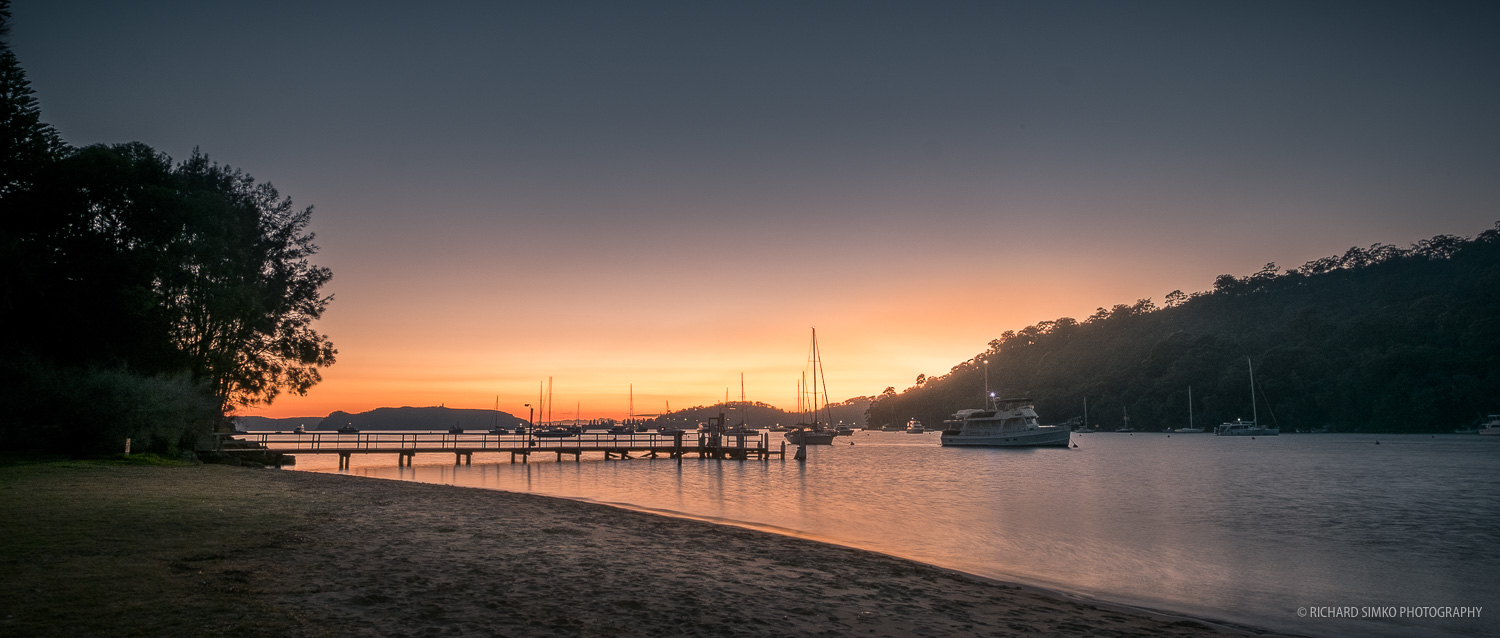 Sunrise at The Basin campground overlooking Pittwater Bay