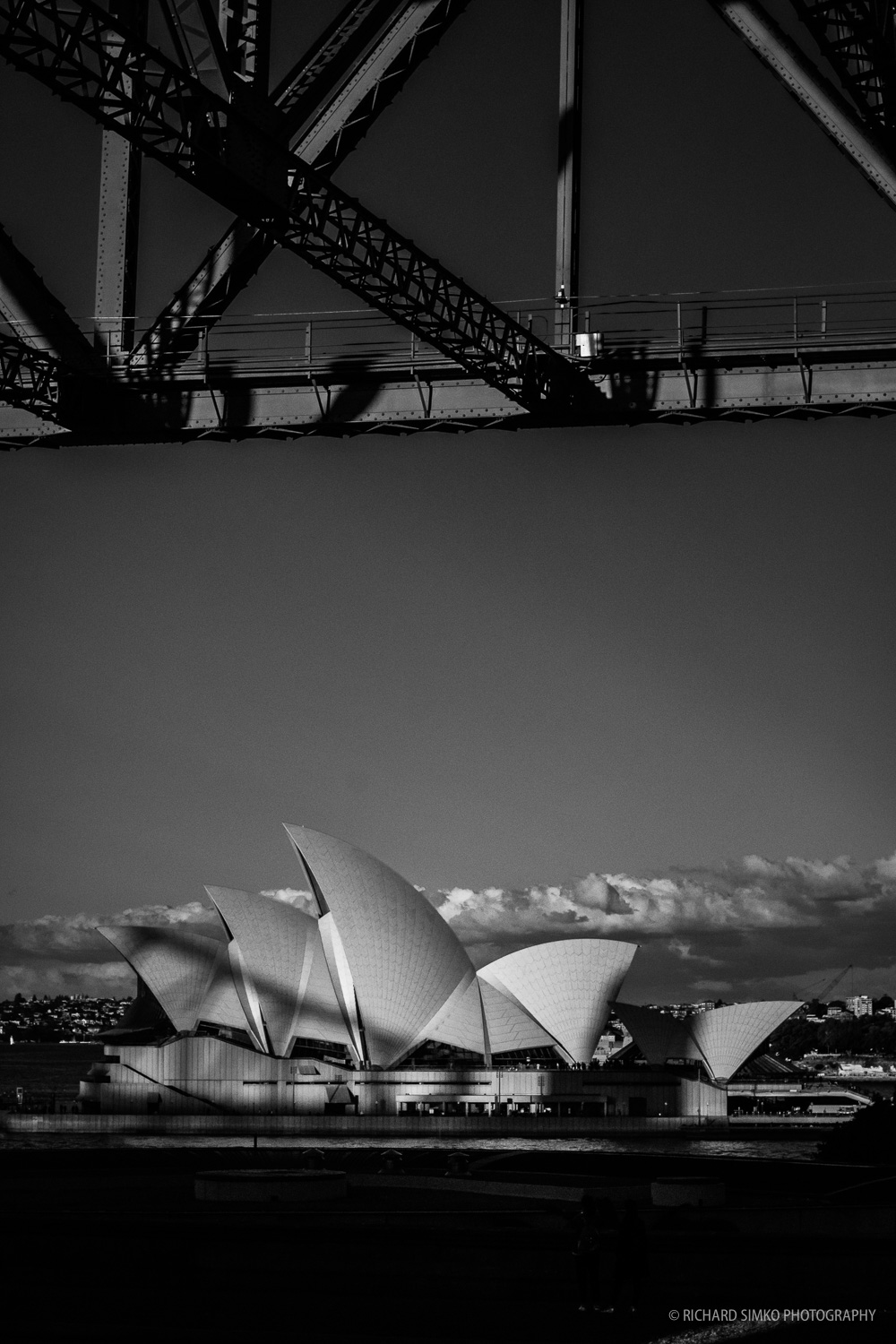 I got myself an Nikon to Fuji X adapter and took my only Nikkor lens that I have for a spin. 50mm 1.4 nifty-fifty works well on a Fujifilm camera. I got to this place just in time for Harbour Bridge cast shadow on the Opera House. I thought is a natural Vivid Sydney but then again, the photograph worked much better in Black and Whine.