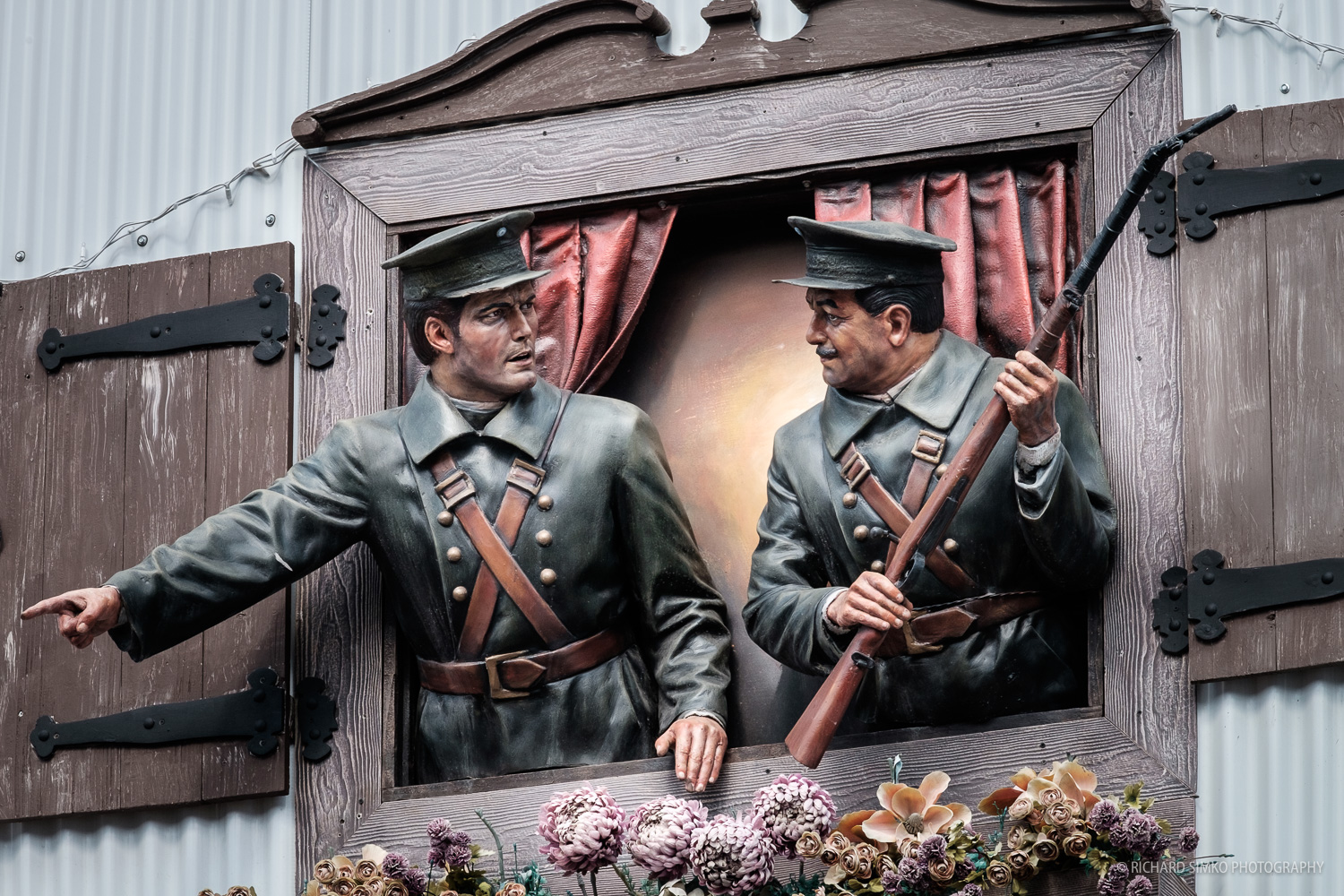 Figurine decorated window at Galeria Tematica. They depict the history of Ushuaia as a penal colony with major prison.
