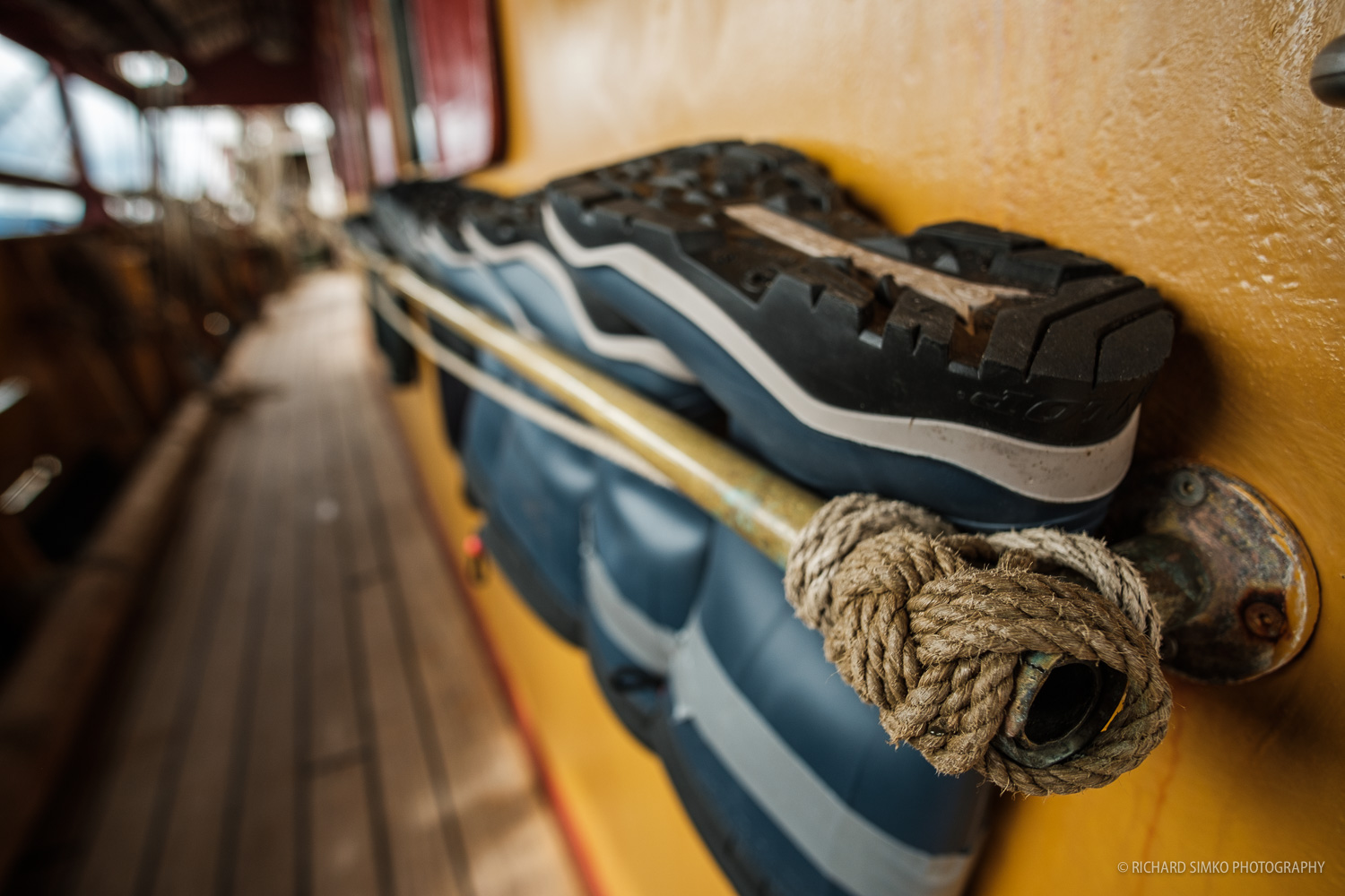 Sailing boots stored in railings on the deckhouse. In wet conditions during sailing through Drake Passage this is an essential piece of gear.