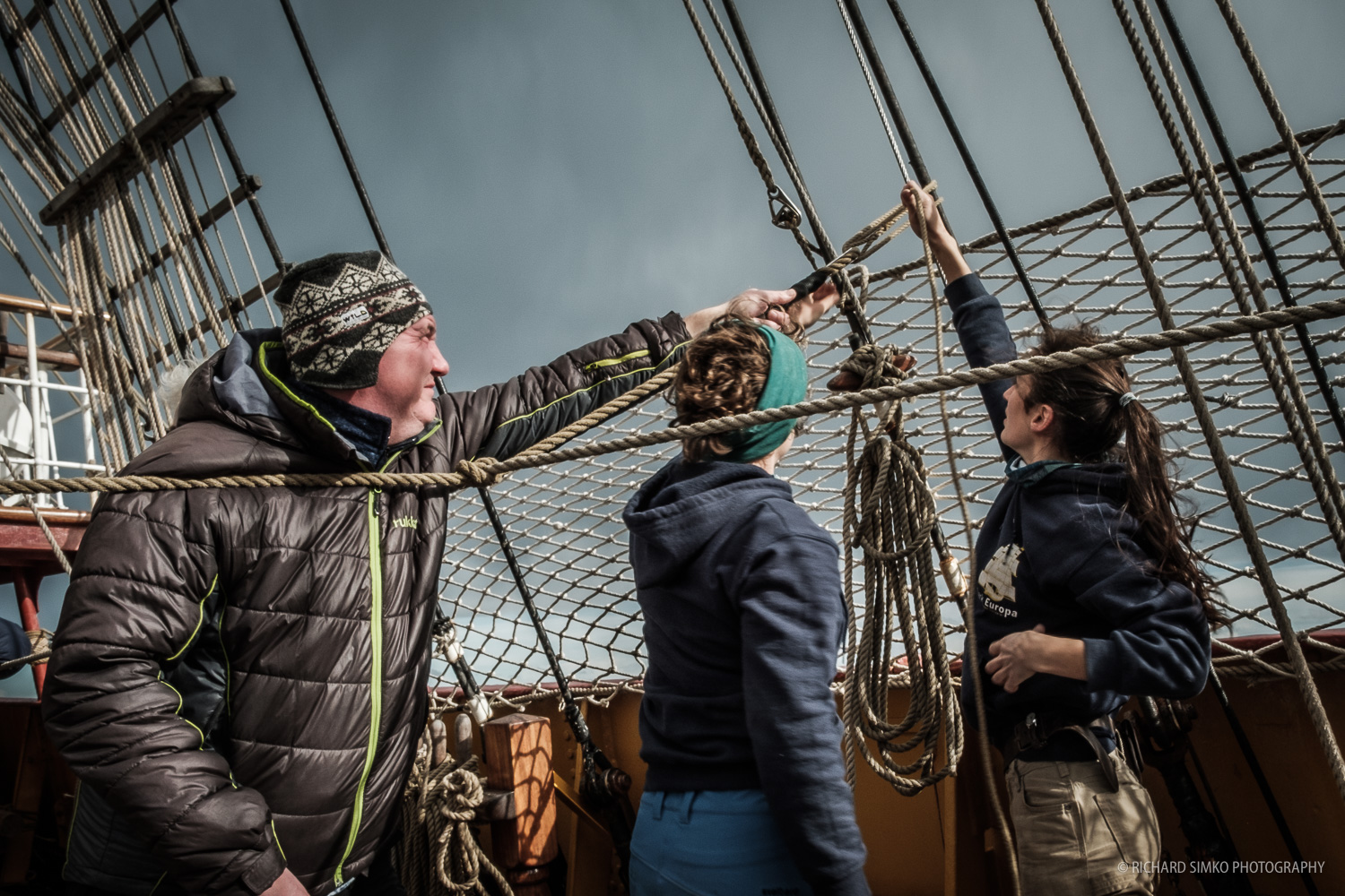 Professional maritime photographer Valery Vasilevskiy lends a helping hand to crew when fixing ropes on the deck.