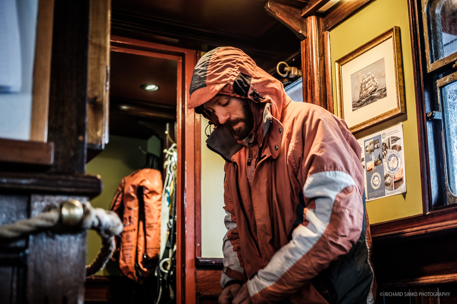 Carlos is getting ready for his shift. Get the wet gear on, put on harness and of he goes into wet misery outside. Well, it is not misery, it is actually pretty cool sailing on the Drake Passage.