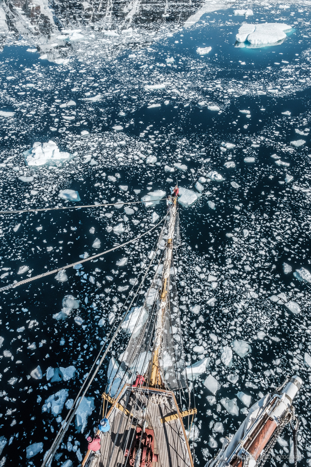 Europa is making her way through sea of ice chunks broken from big glacier during calving activity. wether is beautiful and it is time to go alof or find a spot in bowsprit.
