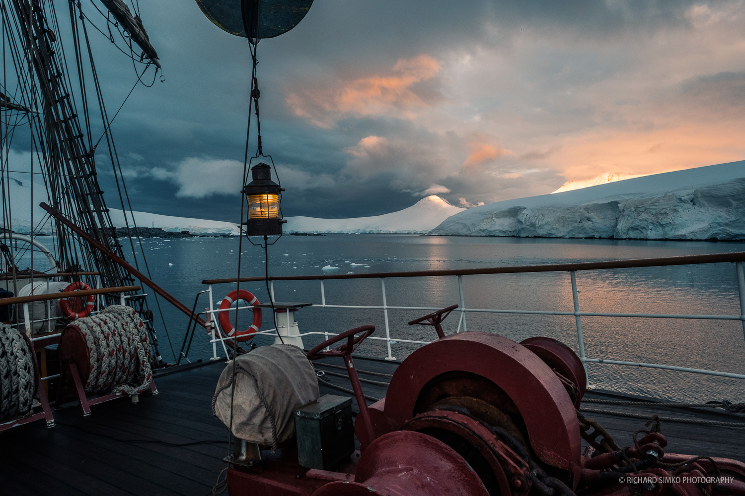 Sunrise. Europa is anchoring near Port Lockroy ant the foot of large Wienke Island glaciers.