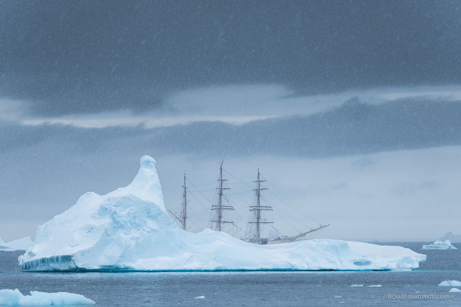 It is snowing, while Europa is drifting between the icebergs waiting for us that are ashore for landing activities.