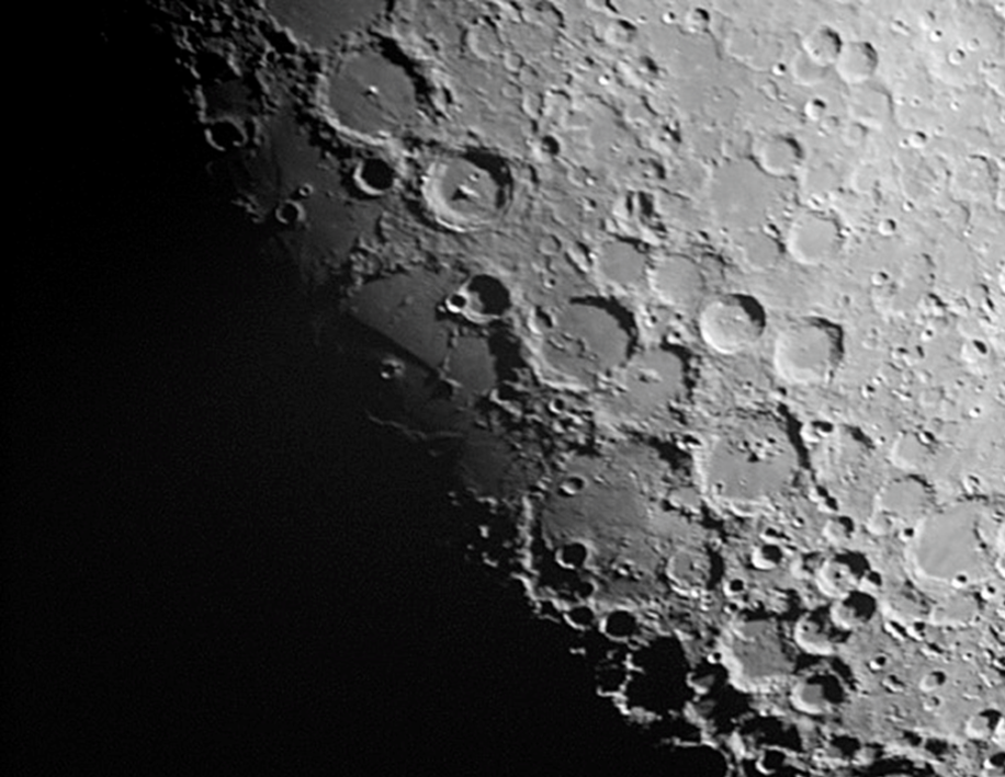 Typical view of the moon through the telescope, showing the 'terminator', where craters show up with sharp shadows.