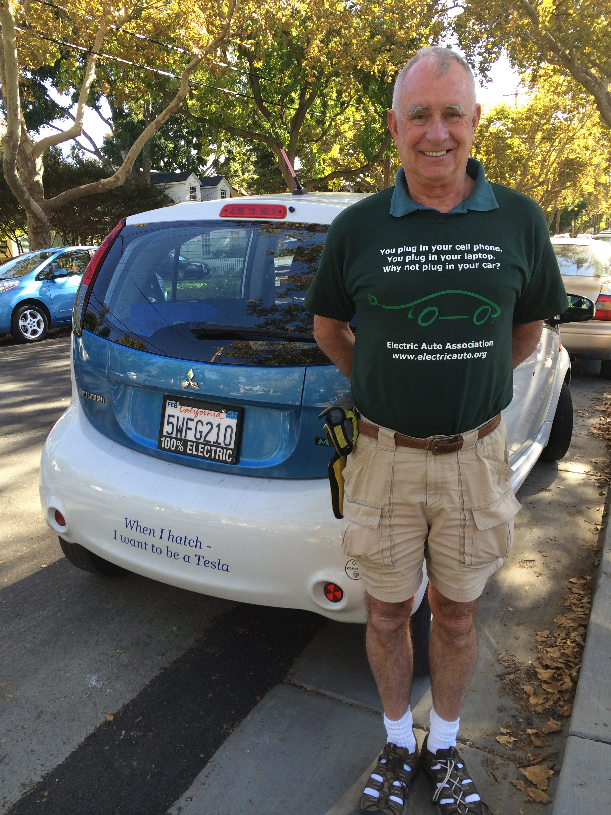 Joe and his Mitsubishi i-MiEV in front of Project Green Home
