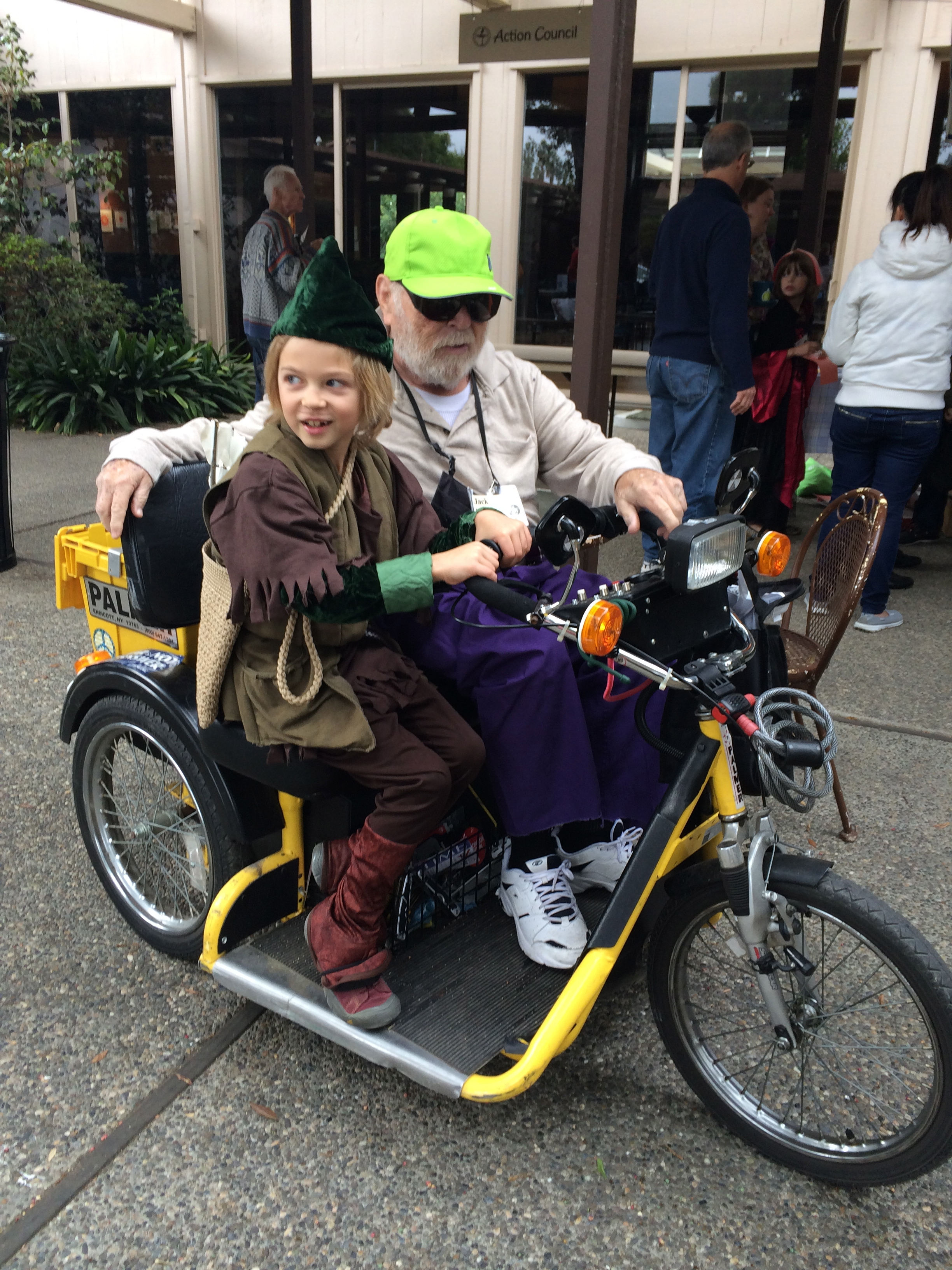 Elliot (aka Robin Hood) gets a ride on an electric tricycle.