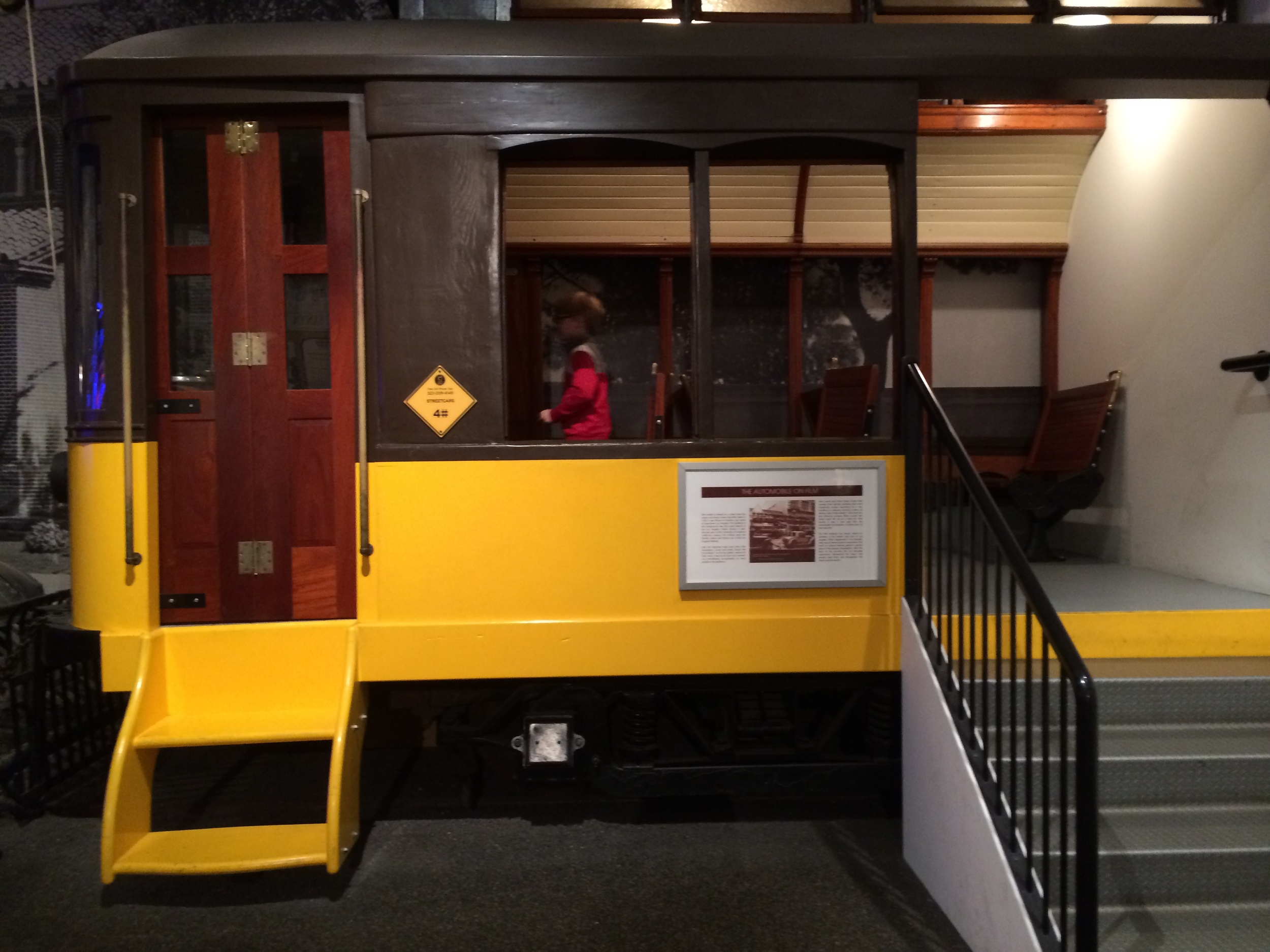 Elliot boards the first exhibit at the Petersen: an electric streetcar.