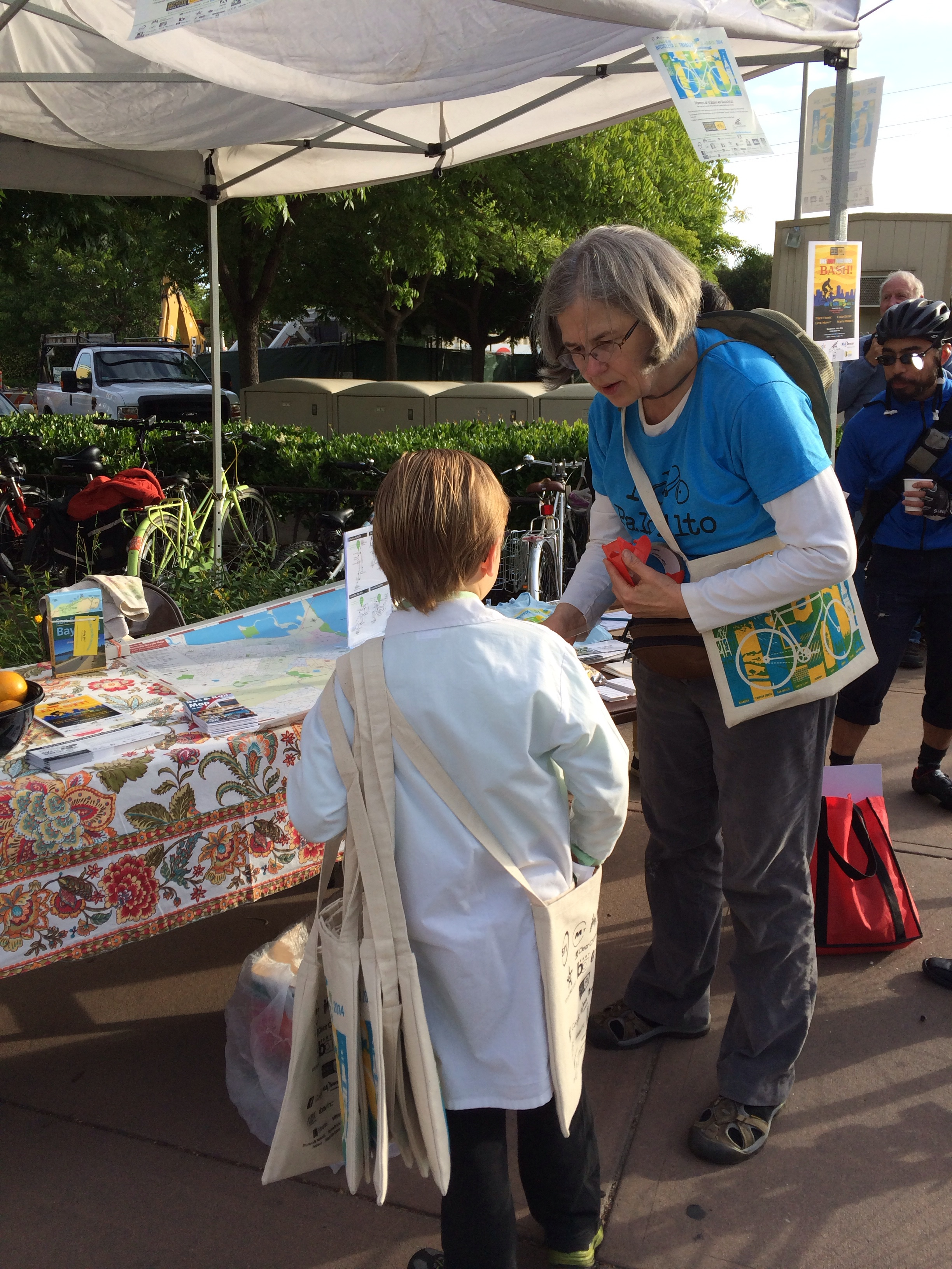 Kathy Durham, Palo Alto's Safe Routes to School/Commute coordinator, gives Elliot goodie bags to hand out.