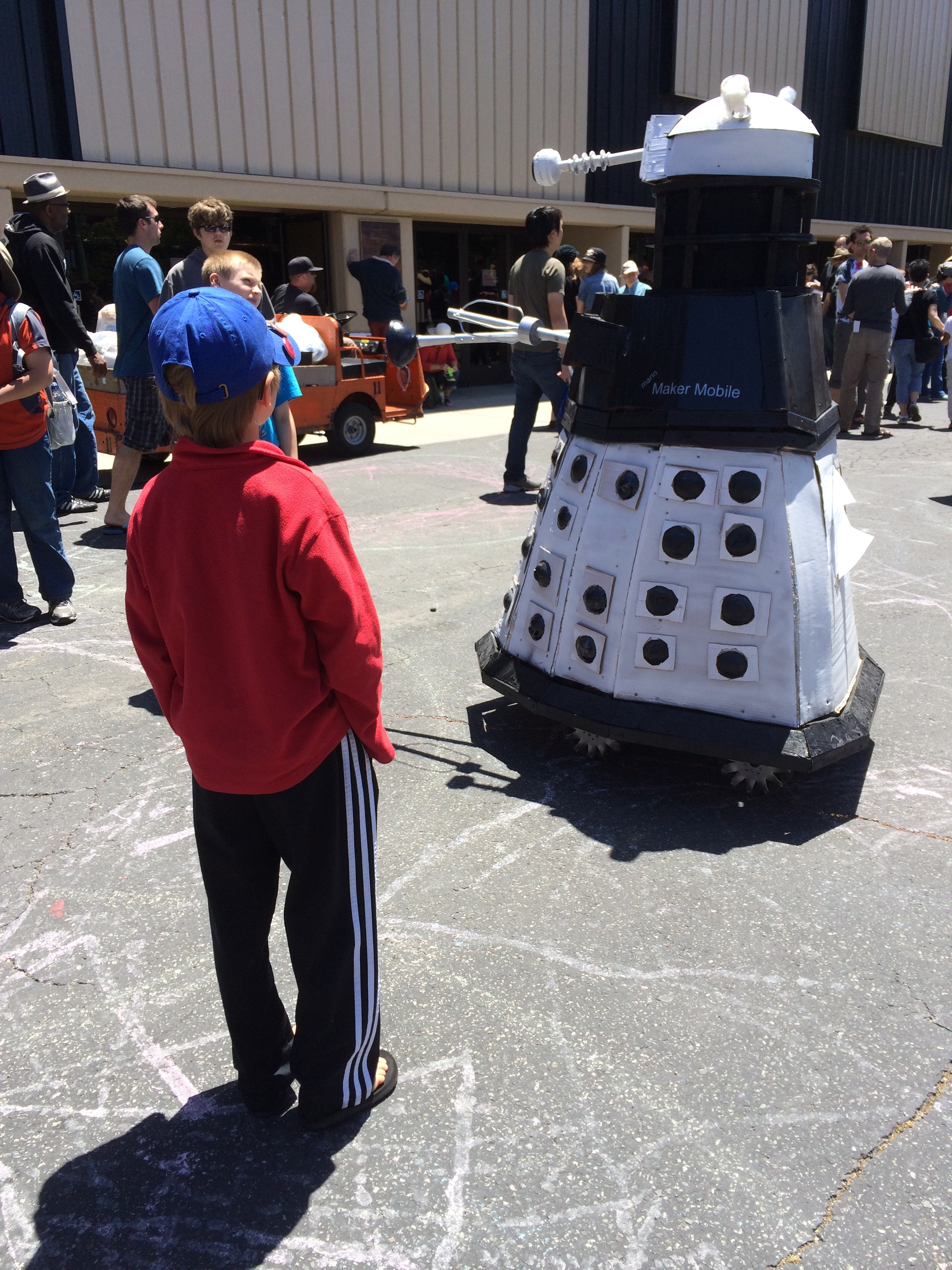Elliot meets a random wandering robot at Maker Faire 2014.