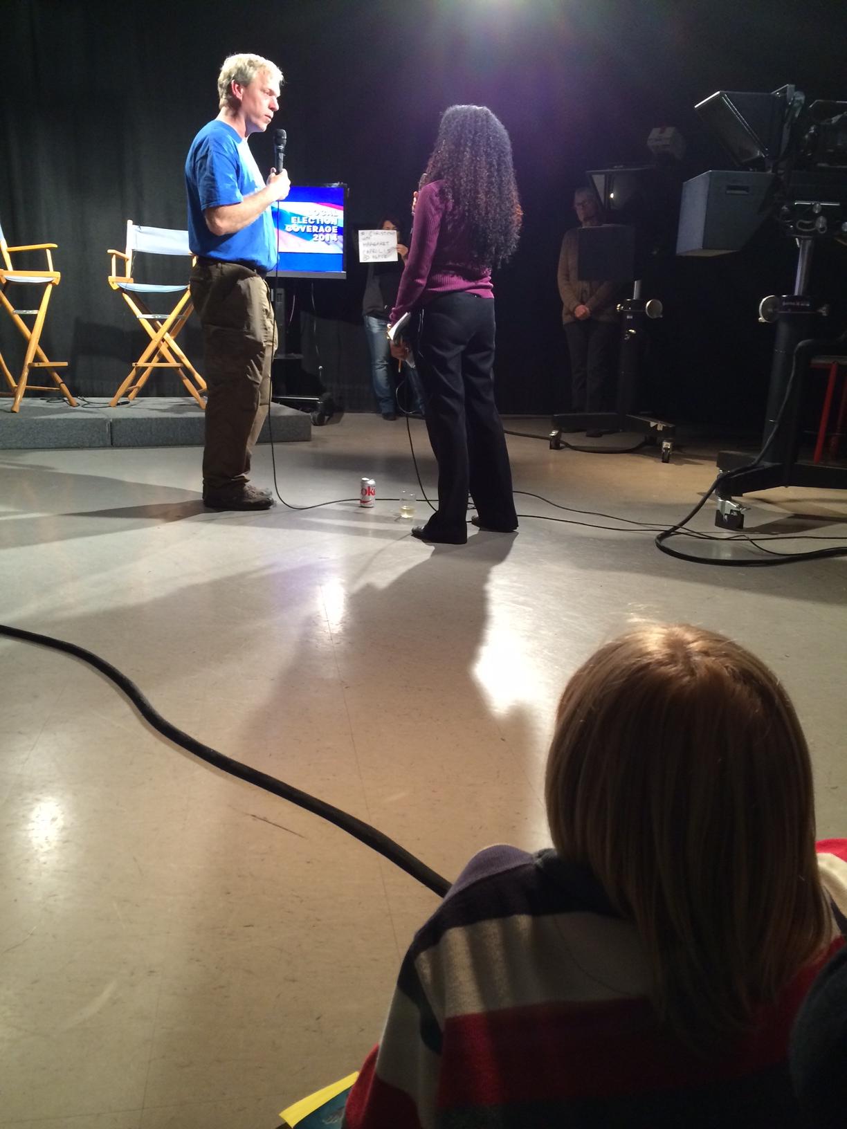 Elliot watches Brian Schmidt interviewed on election night at KMTV.