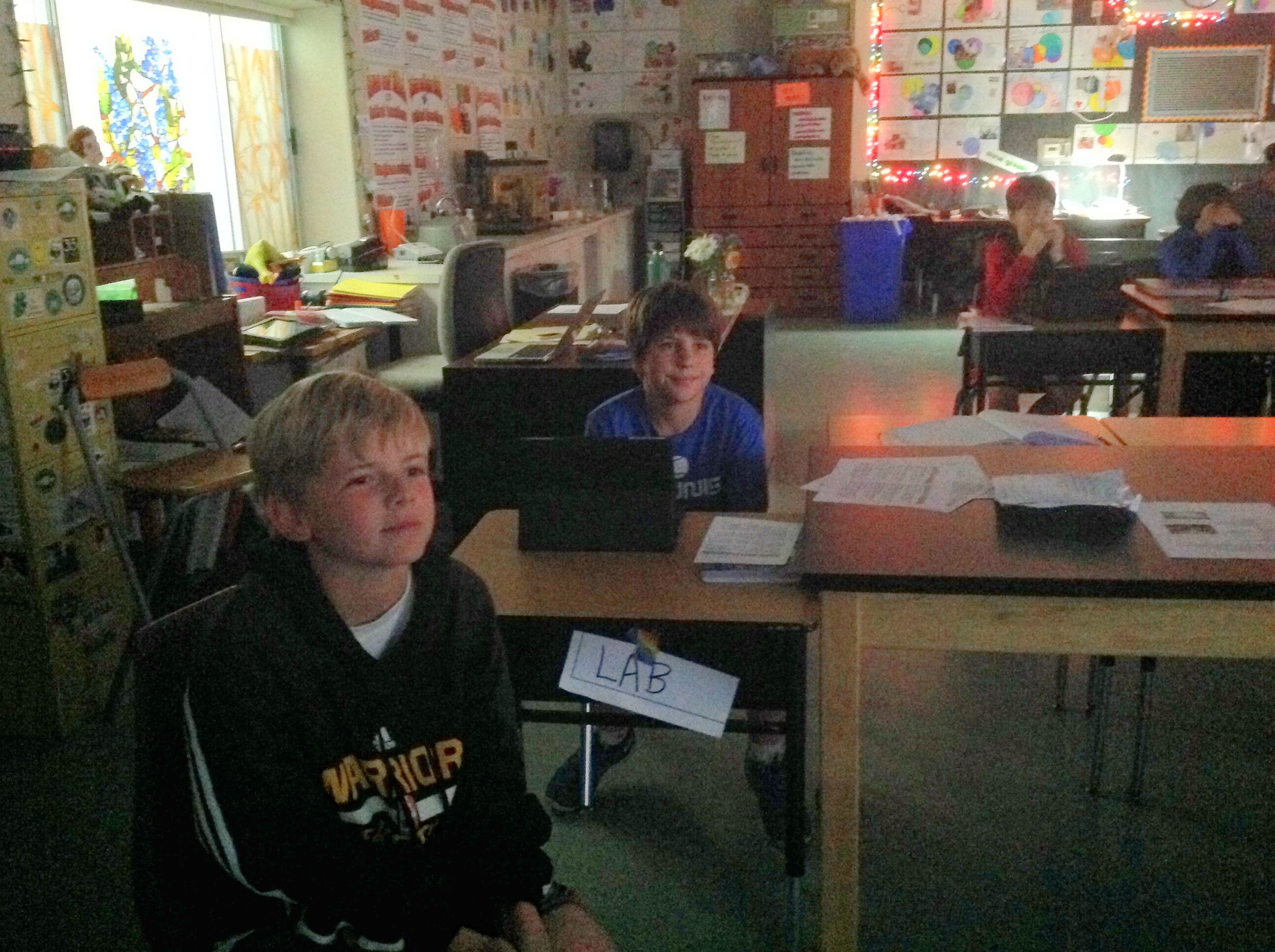 Sixth grade science students watching Worse Than Poop!