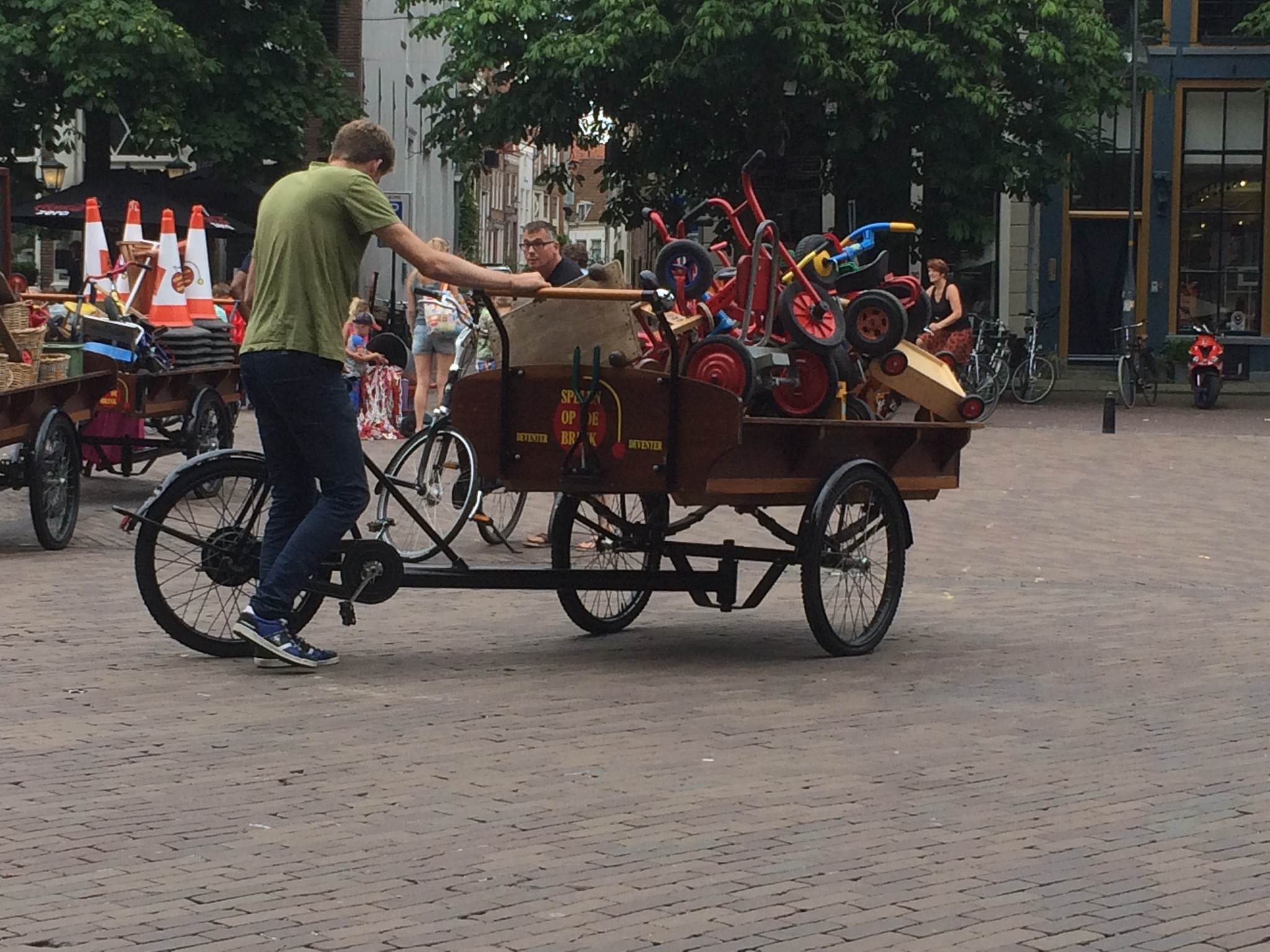 Traditional dutch toys delivered to the Deventer town square... via bicycle wagon, naturally.
