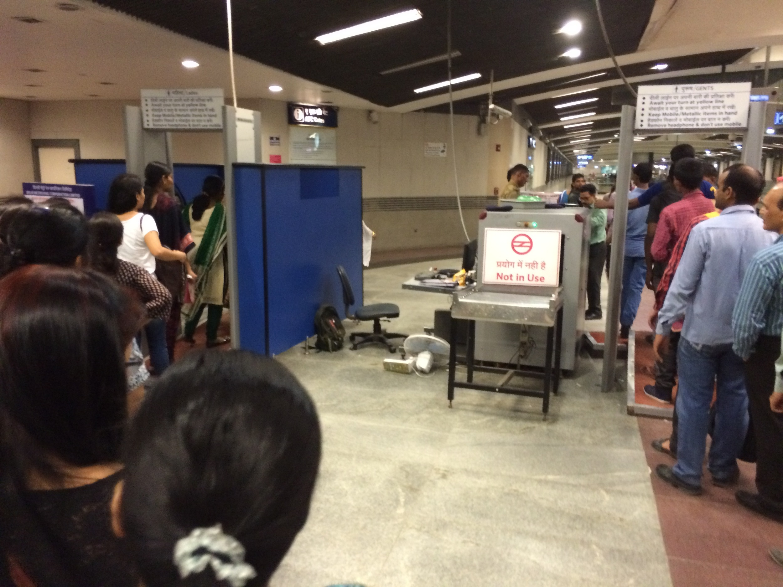 Womens' and mens' security lines for the New Delhi metro.