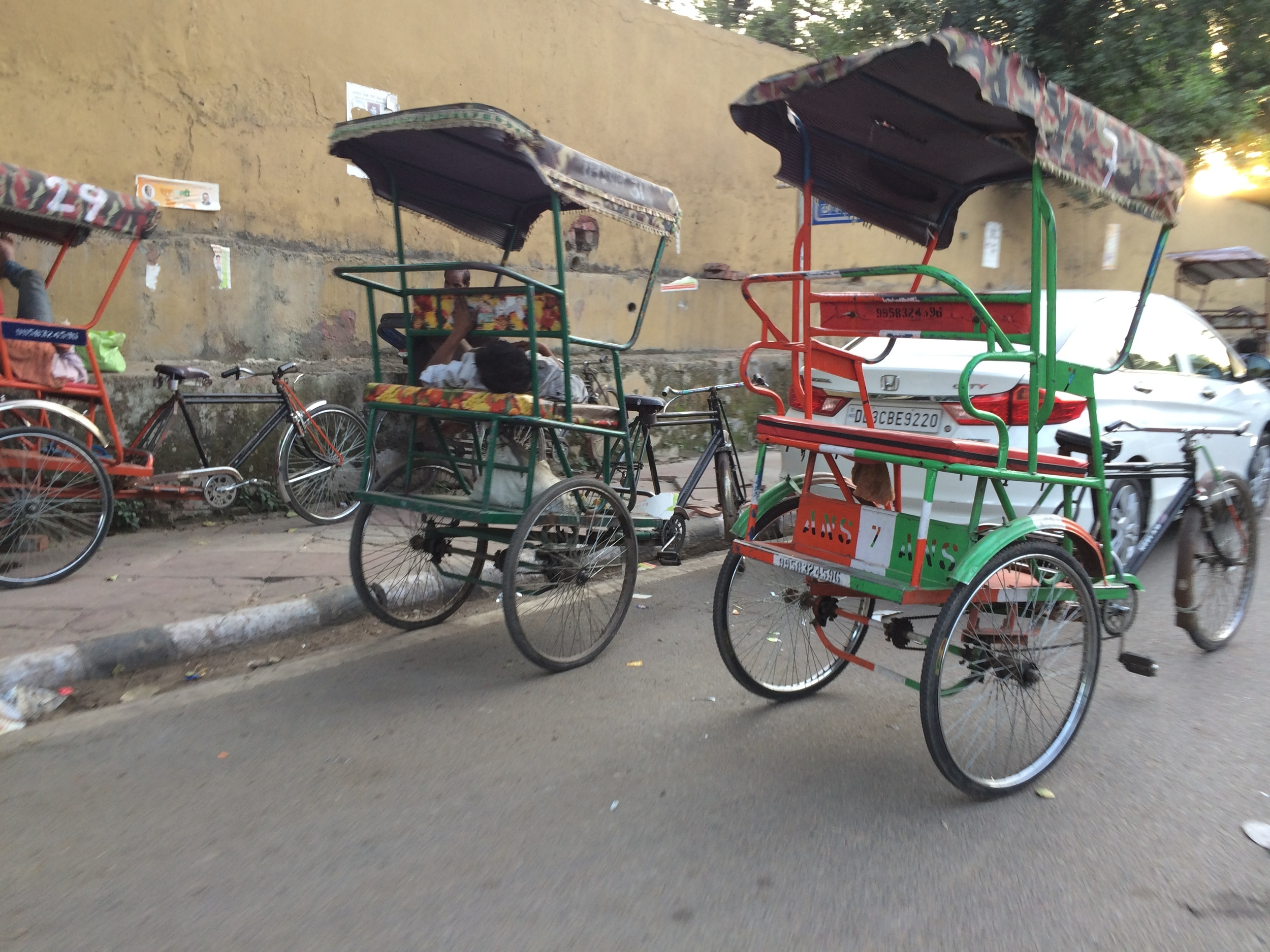 Bicycle rickshaw driver napping in New Delhi