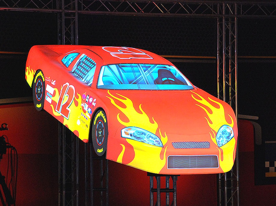 Projection Mapping - Have you ever seen a car that changes colors right before your eyes? Projection mapping surfaces with animation and video is one of our specialties. We've mapped graphics and video to architectural details, geometric shapes and even skyscrapers. Click the pic to see more examples.