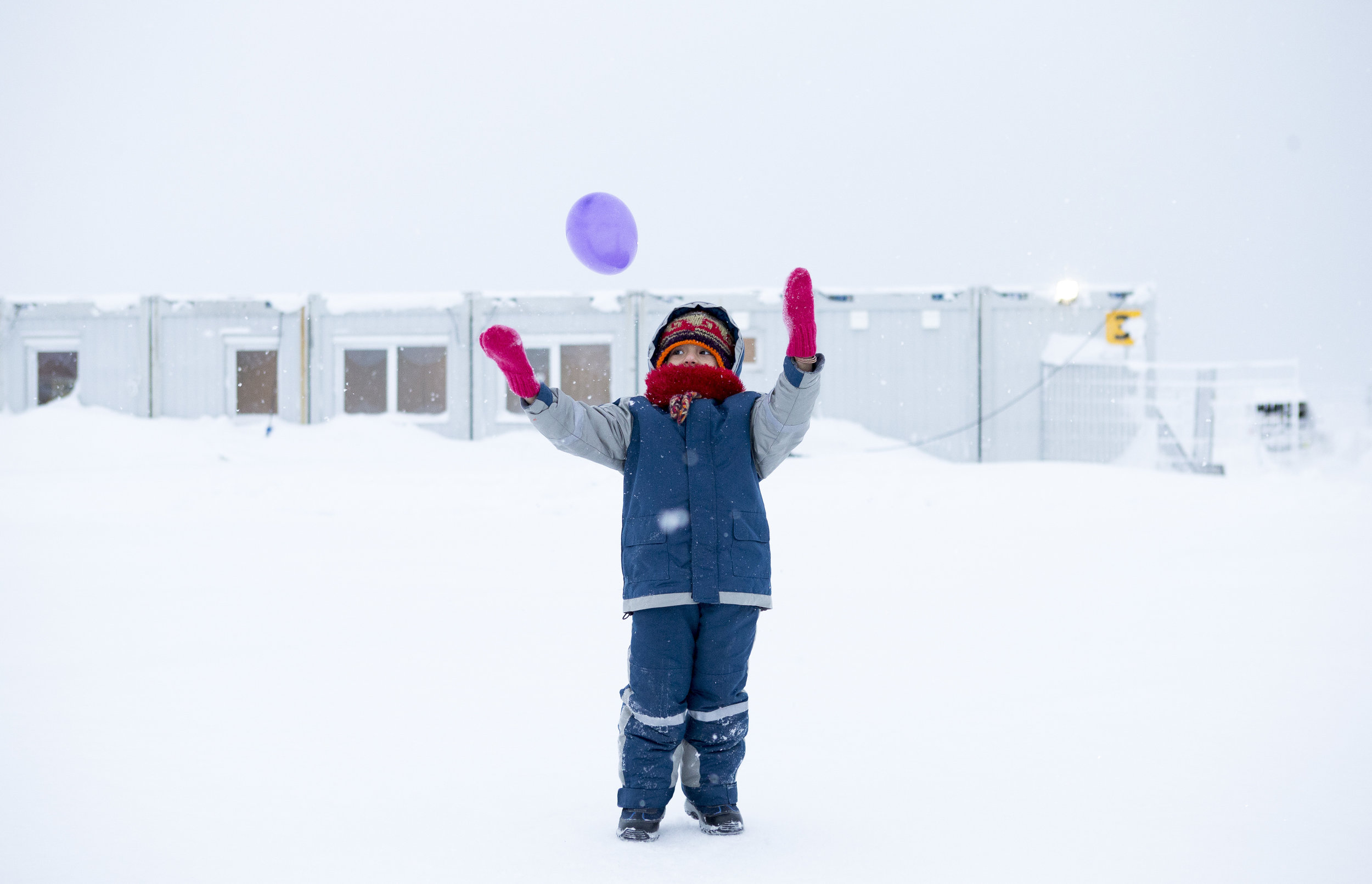 Happily unaware of politics she has been a part of, five year old Zeynep from Afganhestan are playing behind fences in the Western camp, 18 kilometers from Russia.