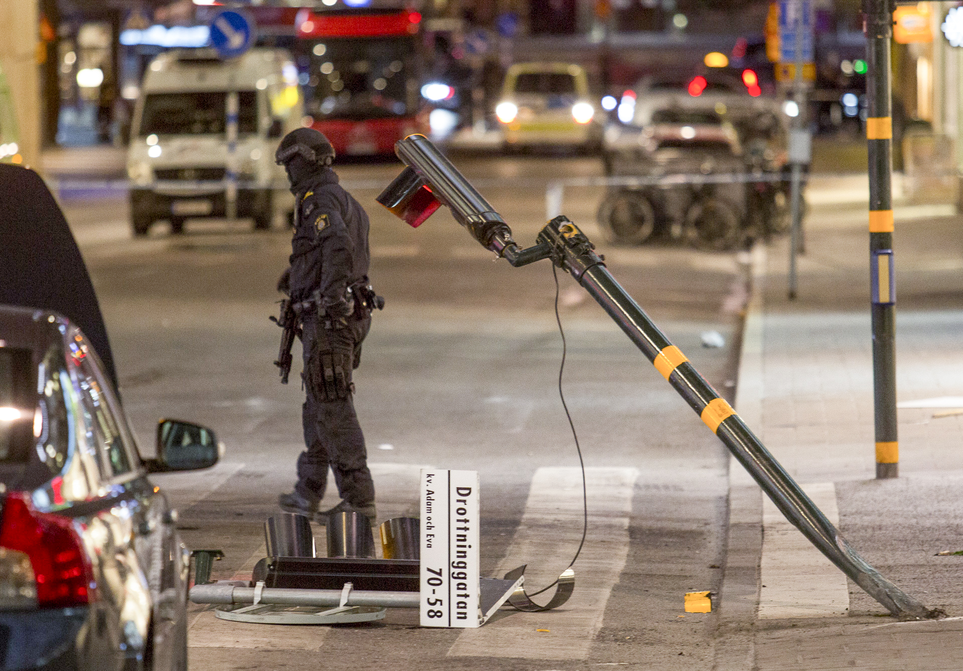 A policeman is guarding Drottninggatan in Stockholm, Sweden. Earlier in the day, a man had driven down the street with a truck in a terrorist attack.  Five people were killed including an eleven-year-old girl and 14 others were seriously injured.