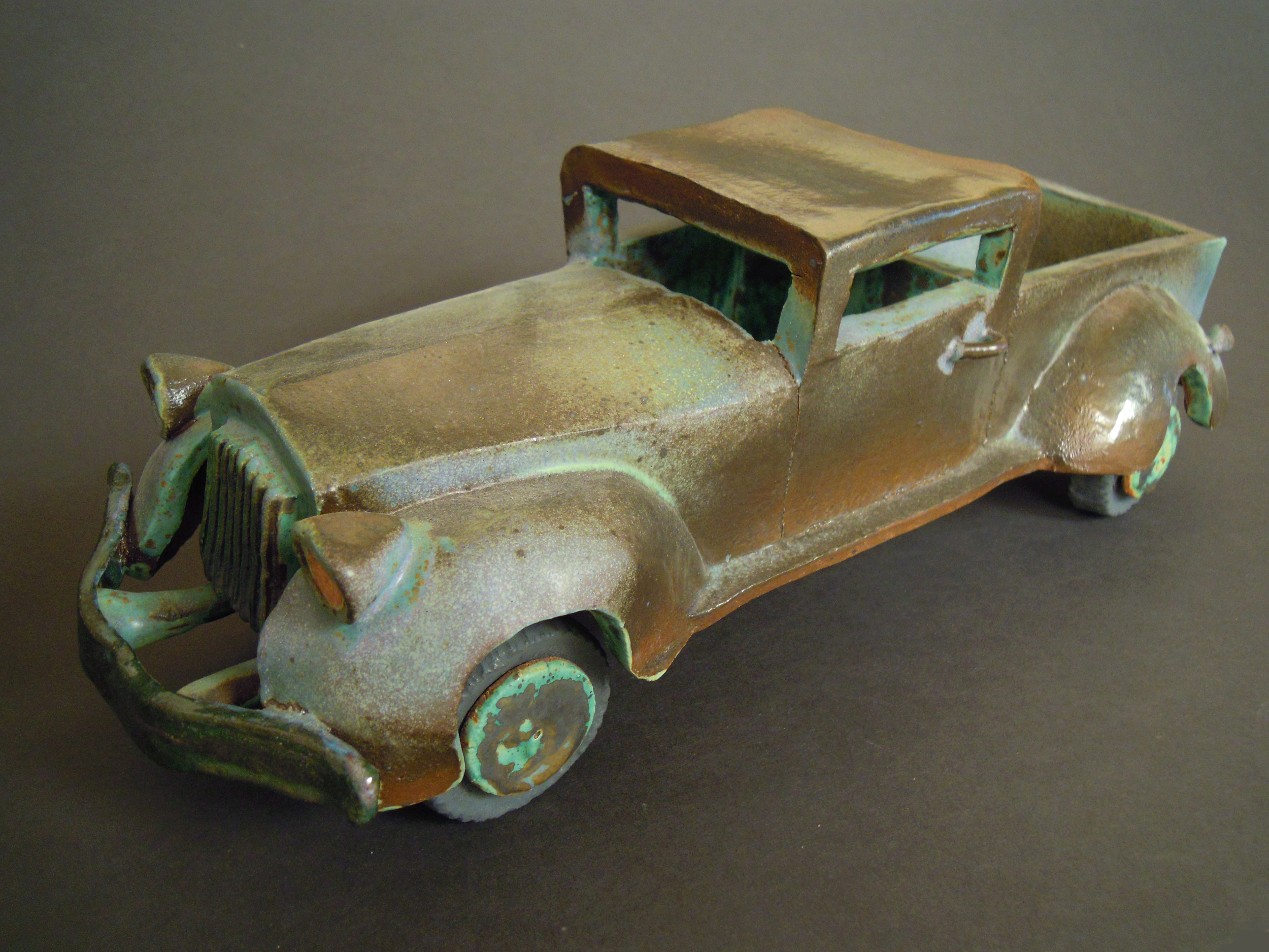 1930's Ford Truck, 2010. The first vehicle, glazed in Val Cushing green and blue. Feels like its been in the desert too long, perhaps it was in the kiln too long