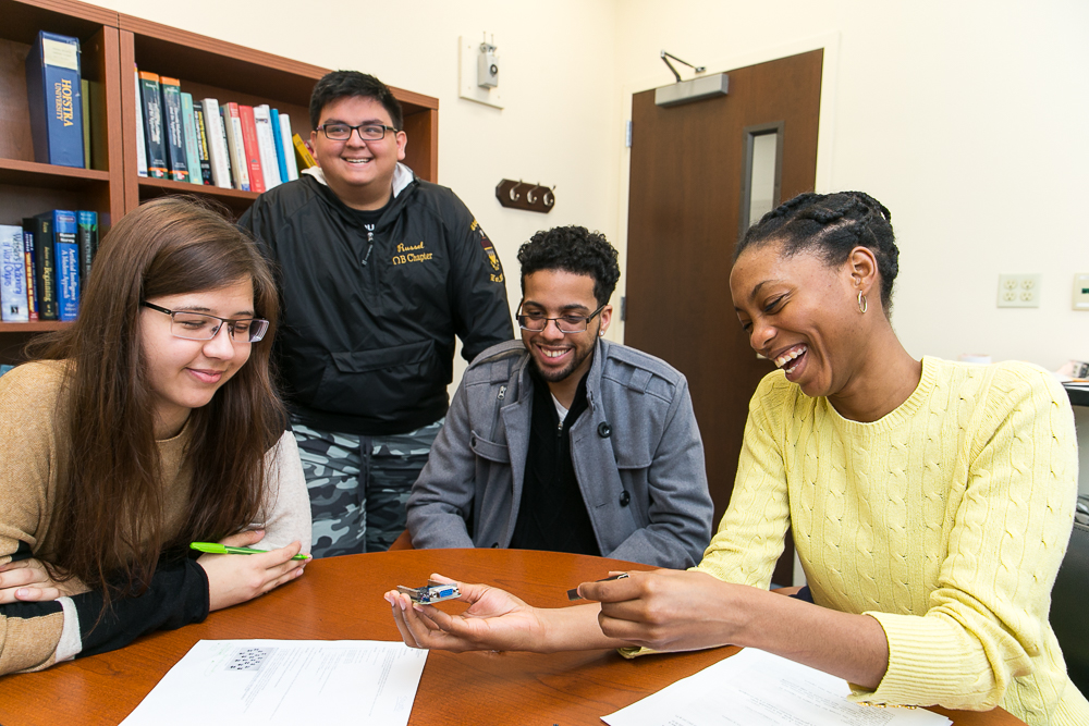 """Hofstra University Computer Science  students gather in professor """"Krish's"""" office to discuss various  Raspberry Pi project ideas and their feasibility for their class project."""