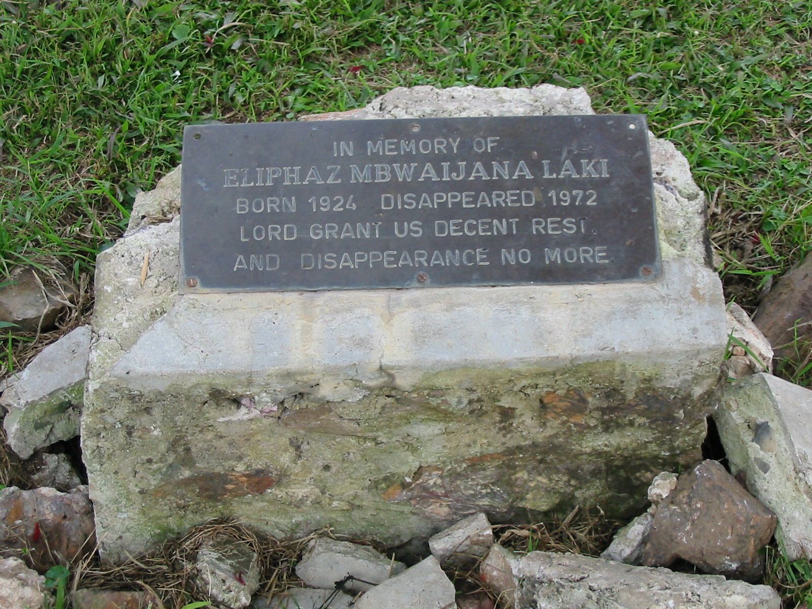 The memorial stone at the Laki family home in Ndeija (Andrew Rice)
