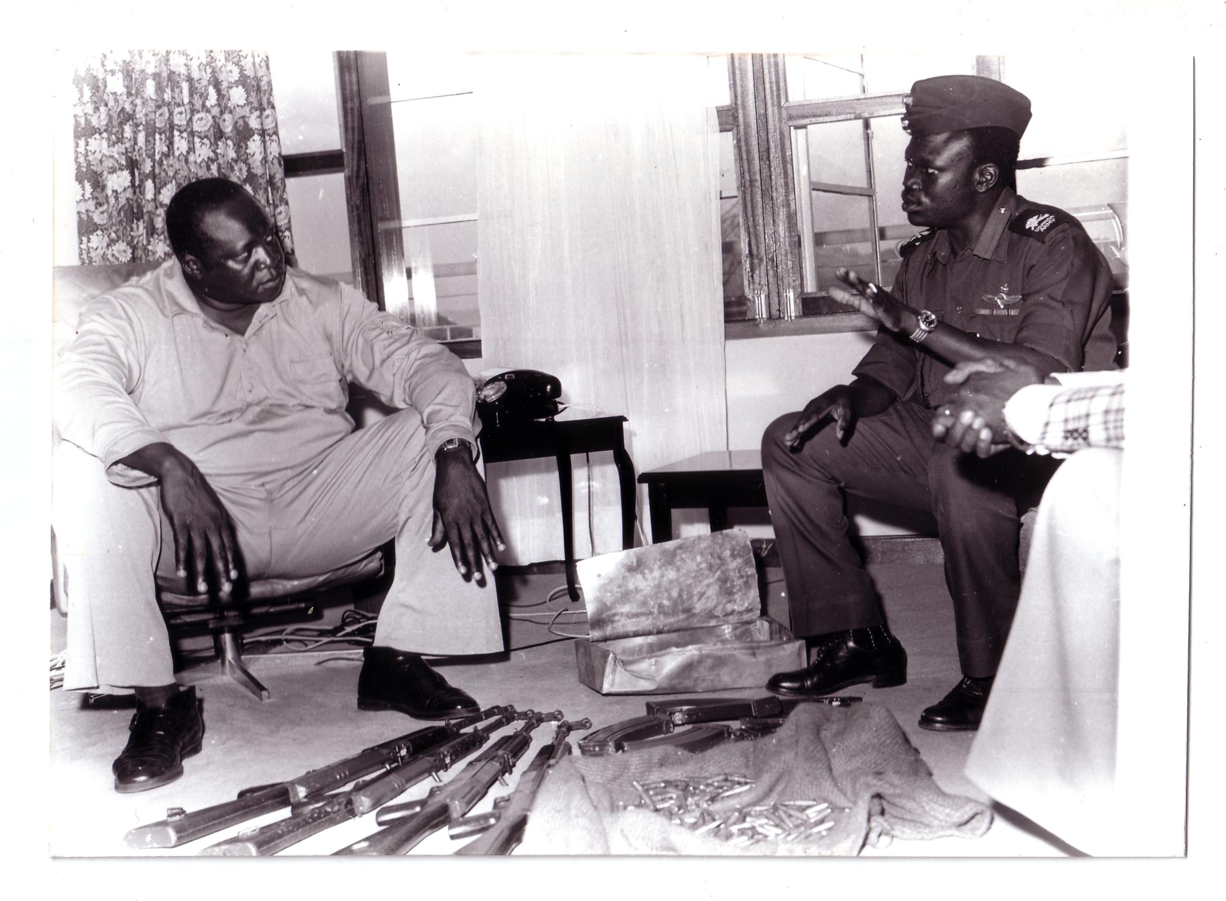 General Idi Amin receives a briefing on subversive activities from his loyal subordinate, Yusuf Gowon. (Radio Uganda)
