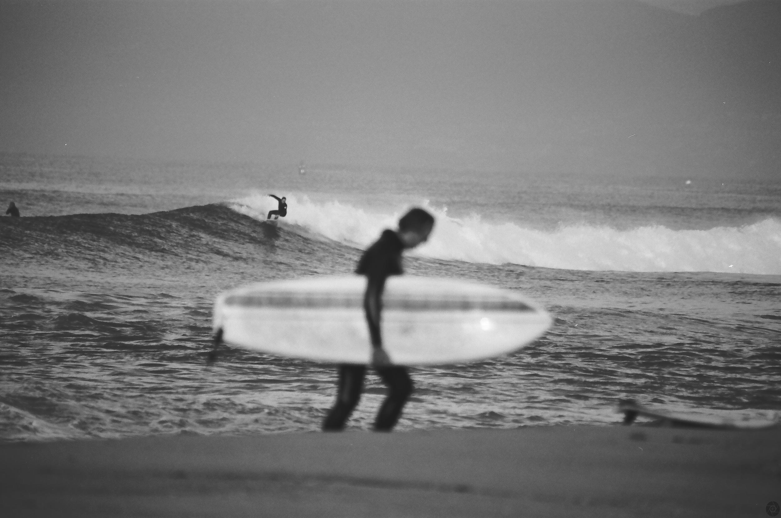 SurferWalkingUpSandElPorto01.jpg
