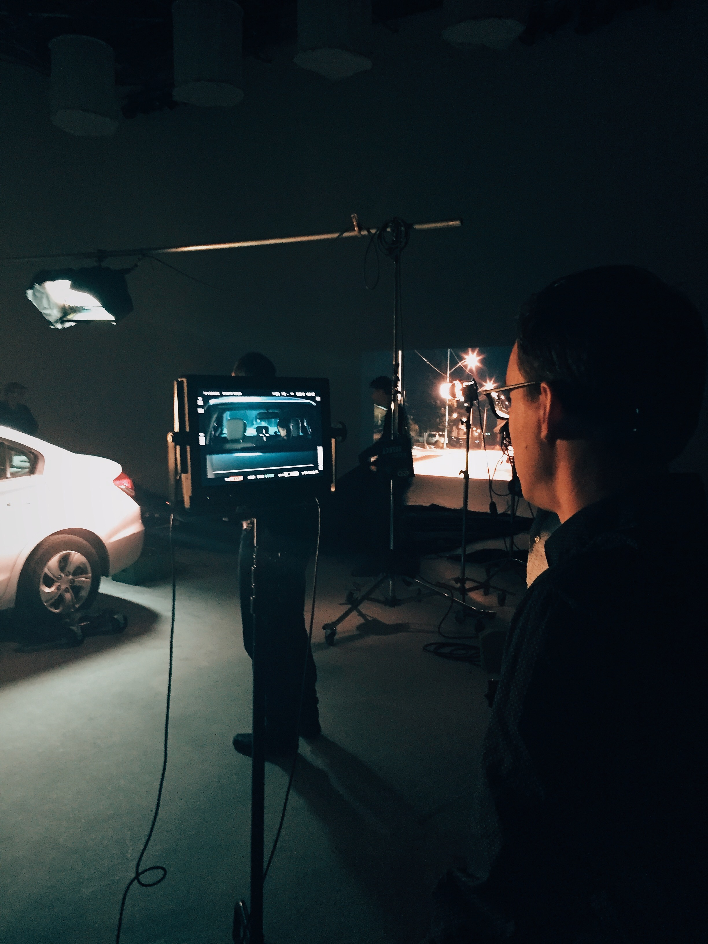 Behind the scenes of our first shoot featuring a full size car, front projection, and plenty of strategically placed lights