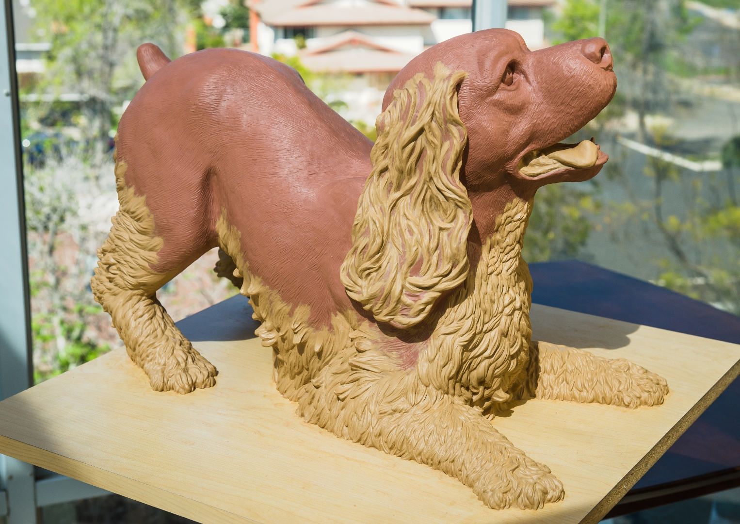 Play Bow.  A memorial to our cocker spaniel Sonny.  The final clay, ready for bronze.    This is a memorial to our cocker spaniel Sonny, in one of his favorite poses, ready to play.  He was a wonderful dog. By Terrence Robertson-Fall.