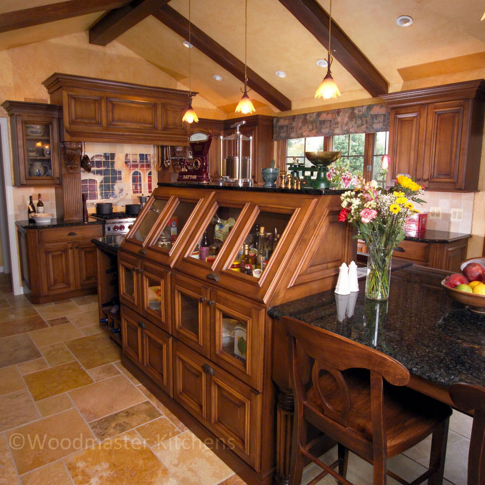 Traditional kitchen design featuring an eye catching island with a European flair.