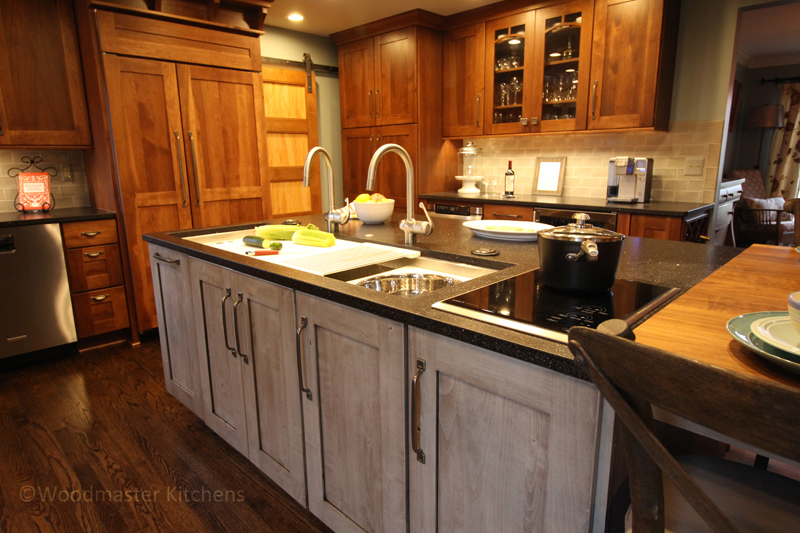 Kitchen design featuring kitchen cabinets in three different textures and glass-front cabinets.