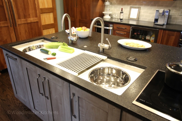 Kitchen design with an island featuring a large Galley Sink with double sinks to accommodate two cooks.