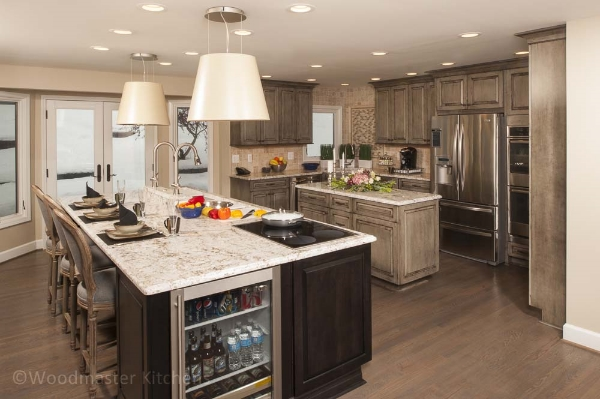 Kitchen design with two islands and a beverage refrigerator.