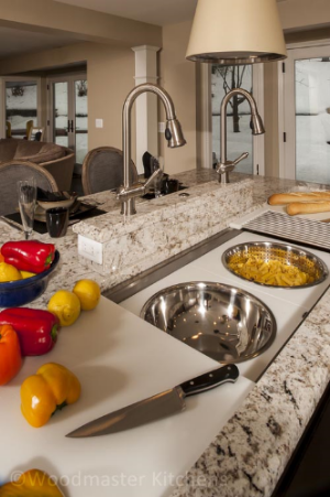 Kitchen design with an island featuring The Galley Sink.