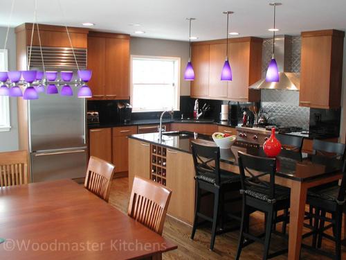 modern kitchen design with a quilted stainless steel backsplash
