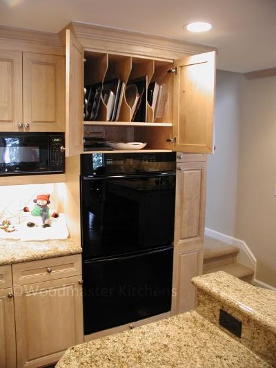 Tray Divider storage inserts in kitchen cabinets.