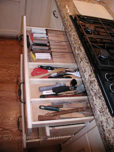 Drawer insert for knives and cooking utensils.